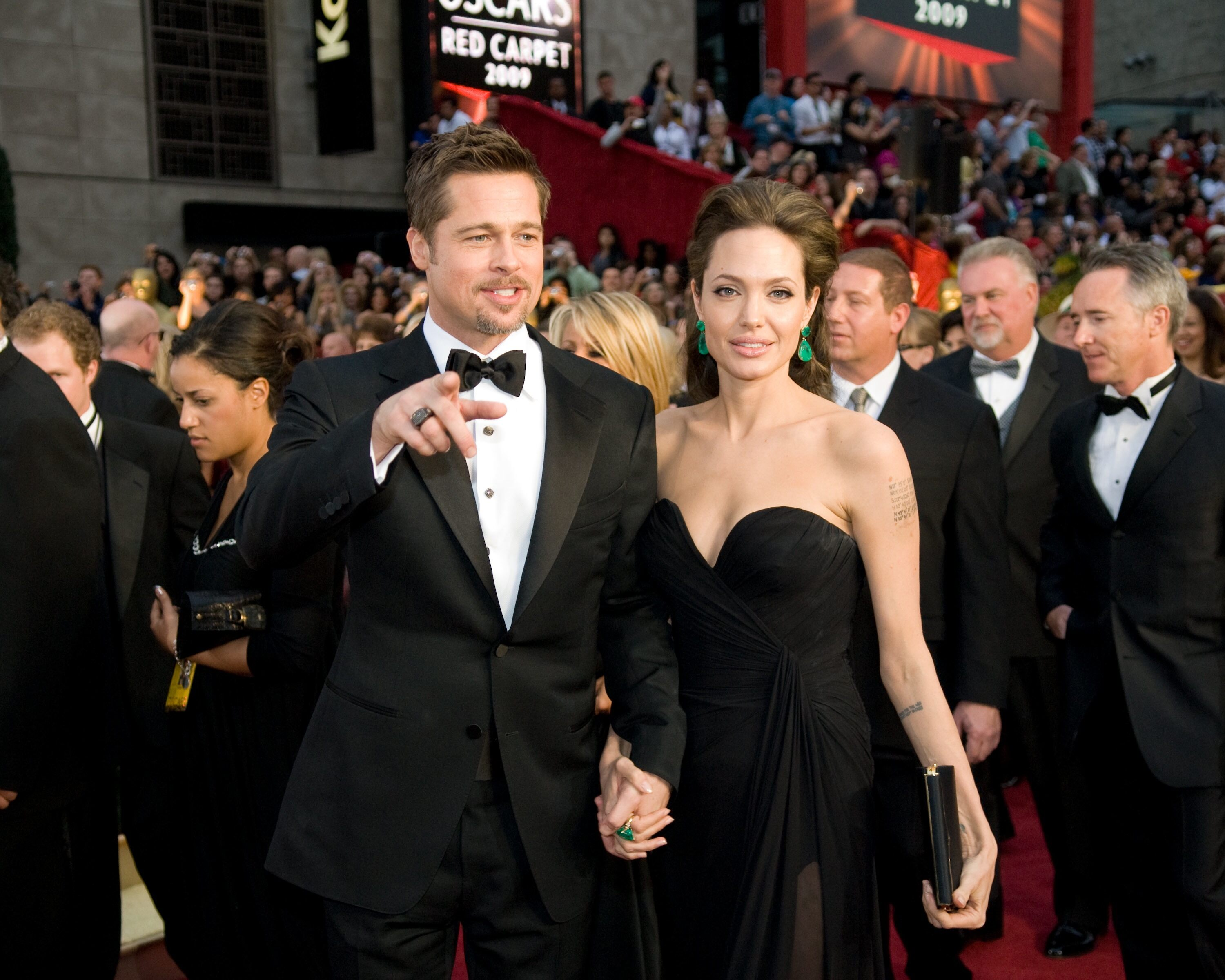 "Brad Pitt, nominated for Actor in a Supporting Role for his role in ""The Curious Case of Benjamin Button"" and Angelina Jolie, nominated for Actress in a Leading Role for her role in ""Changeling."""