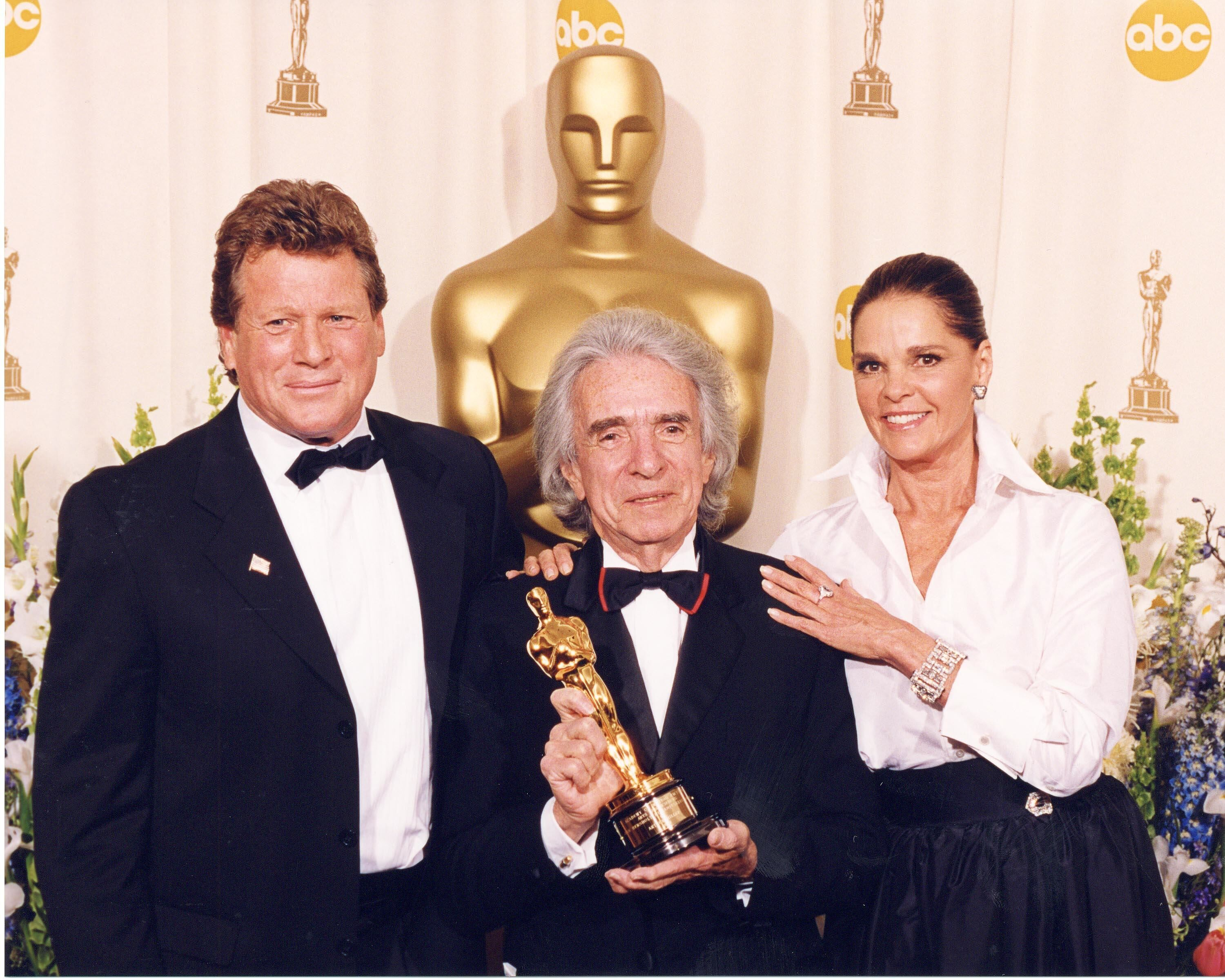 Jean Hersholt Humanitarian Award winner Arthur Hiller with presenters Ryan O'Neal and Ali MacGraw.