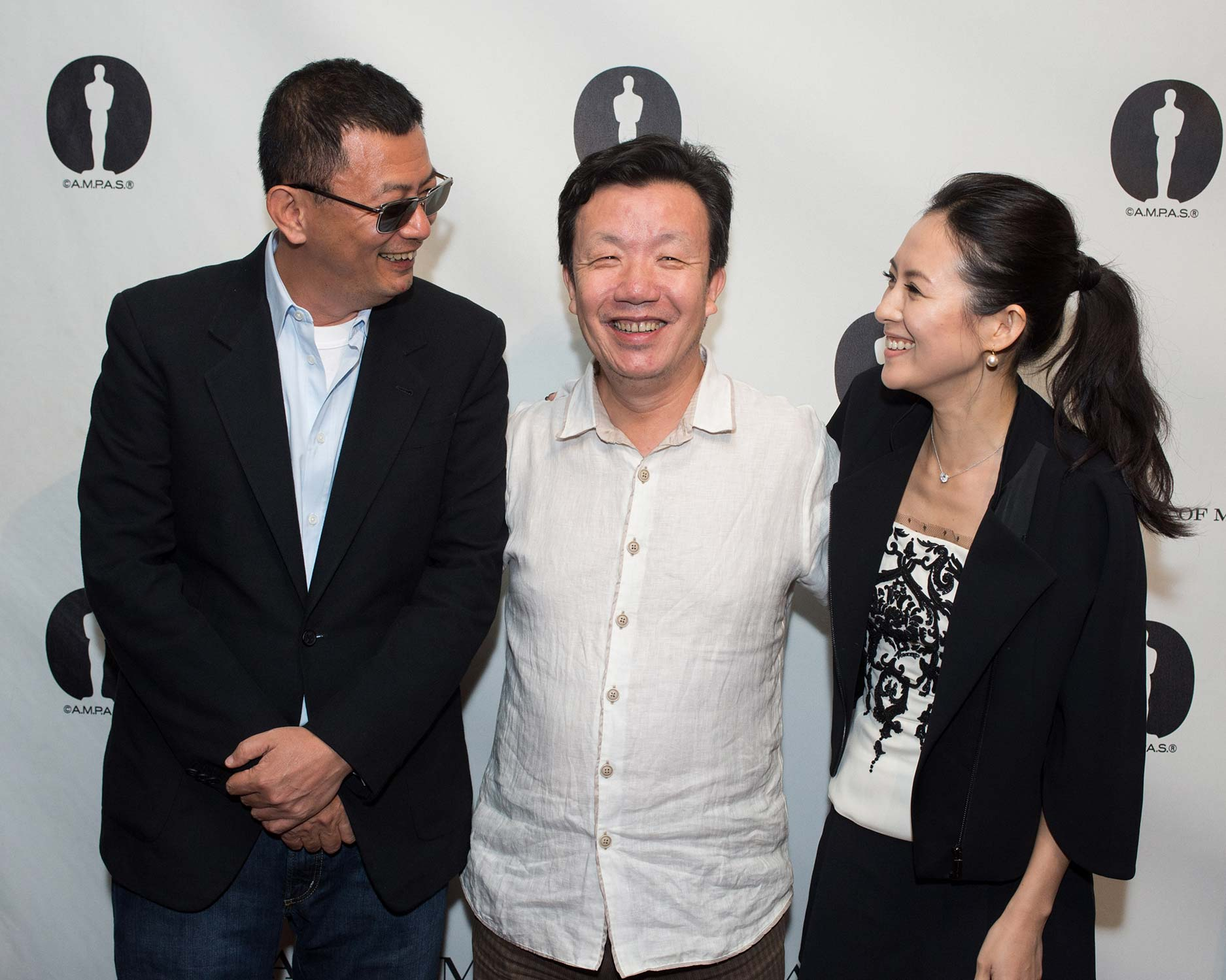 Writer-director Wong Kar Wai (left), writer Zou Jingzhi (center) and actress Ziyi Zhang