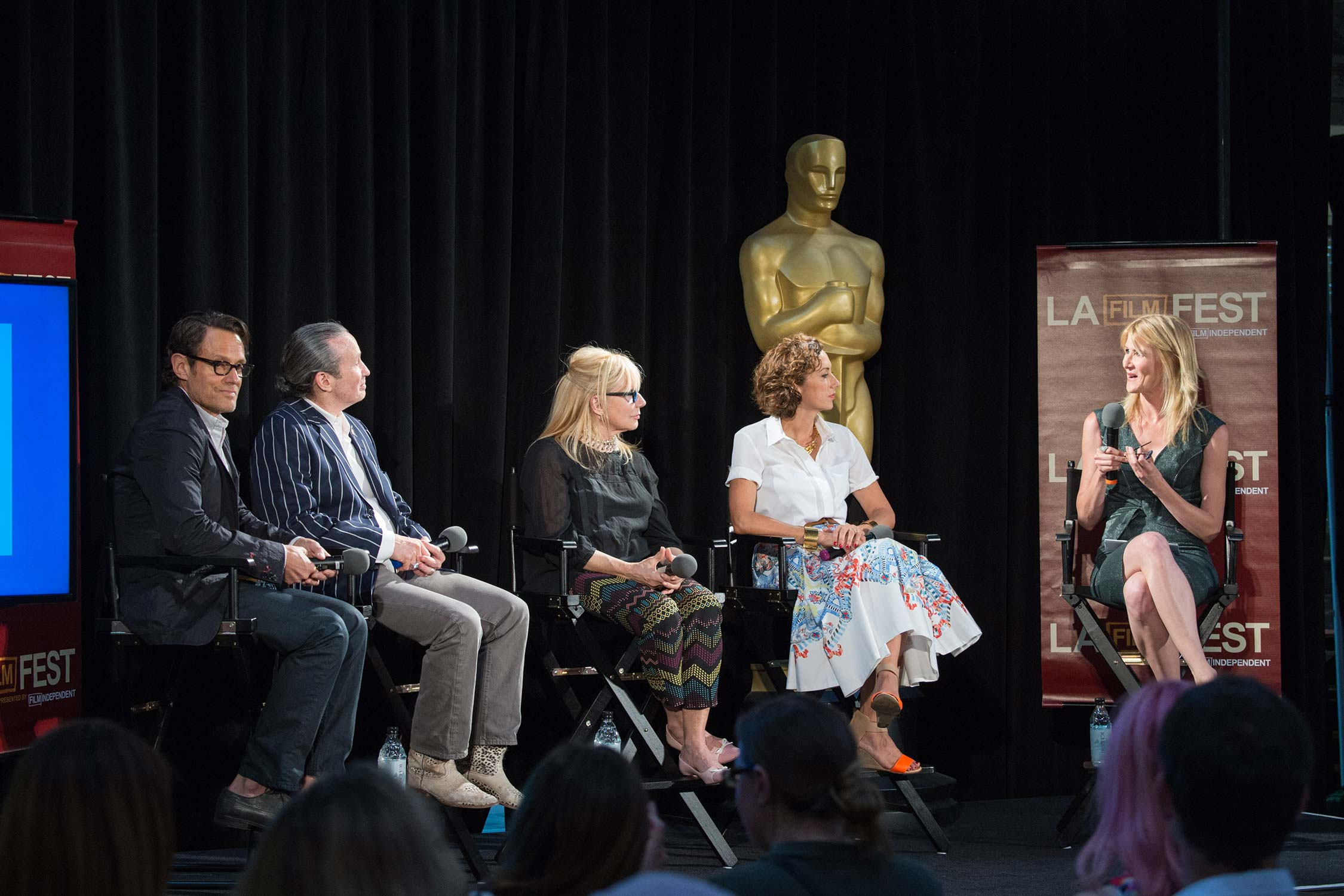 The panelists with moderator Laura Dern.