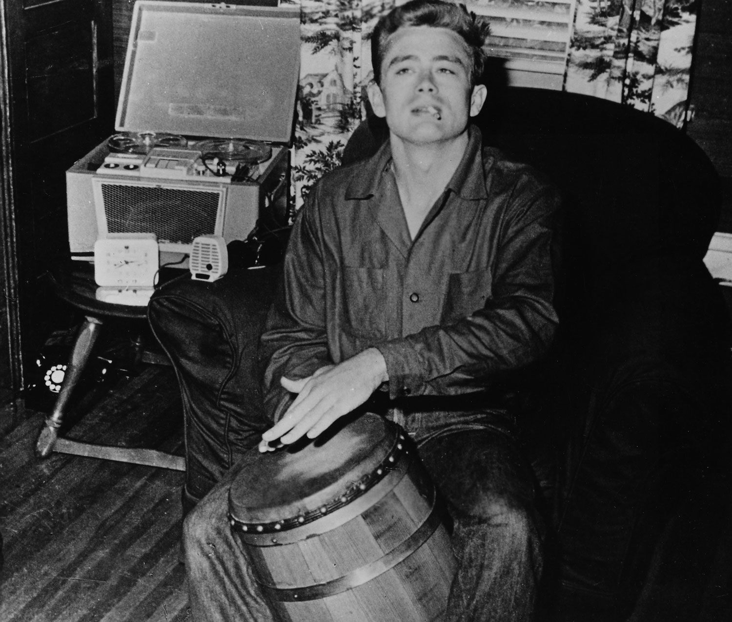 James Dean shows off his musical side with a conga drum.