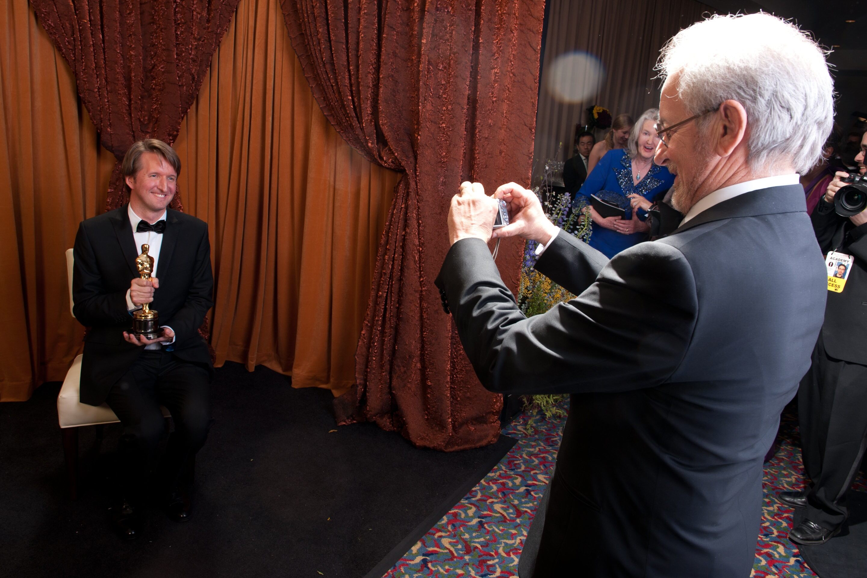 "Oscar®-winning director Tom Hooper, winner for Achievement in Directing for work done on ""The King's Speech"", poses for presenter Steven Spielberg backstage."