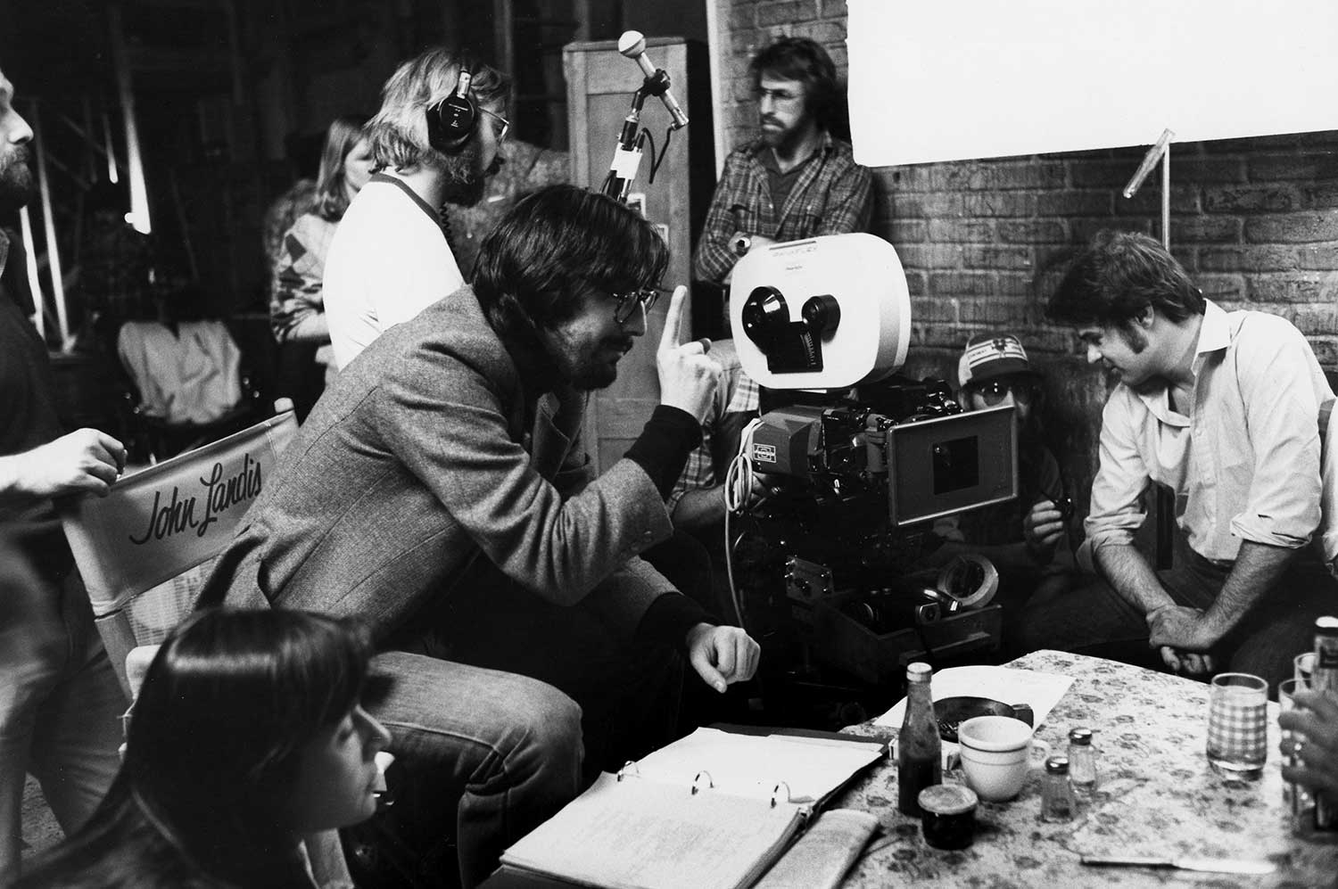 Seen here during production on THE BLUES BROTHERS, director John Landis had a major success at Universal with NATIONAL LAMPOON'S ANIMAL HOUSE and also helmed THE KENTUCKY FRIED MOVIE.