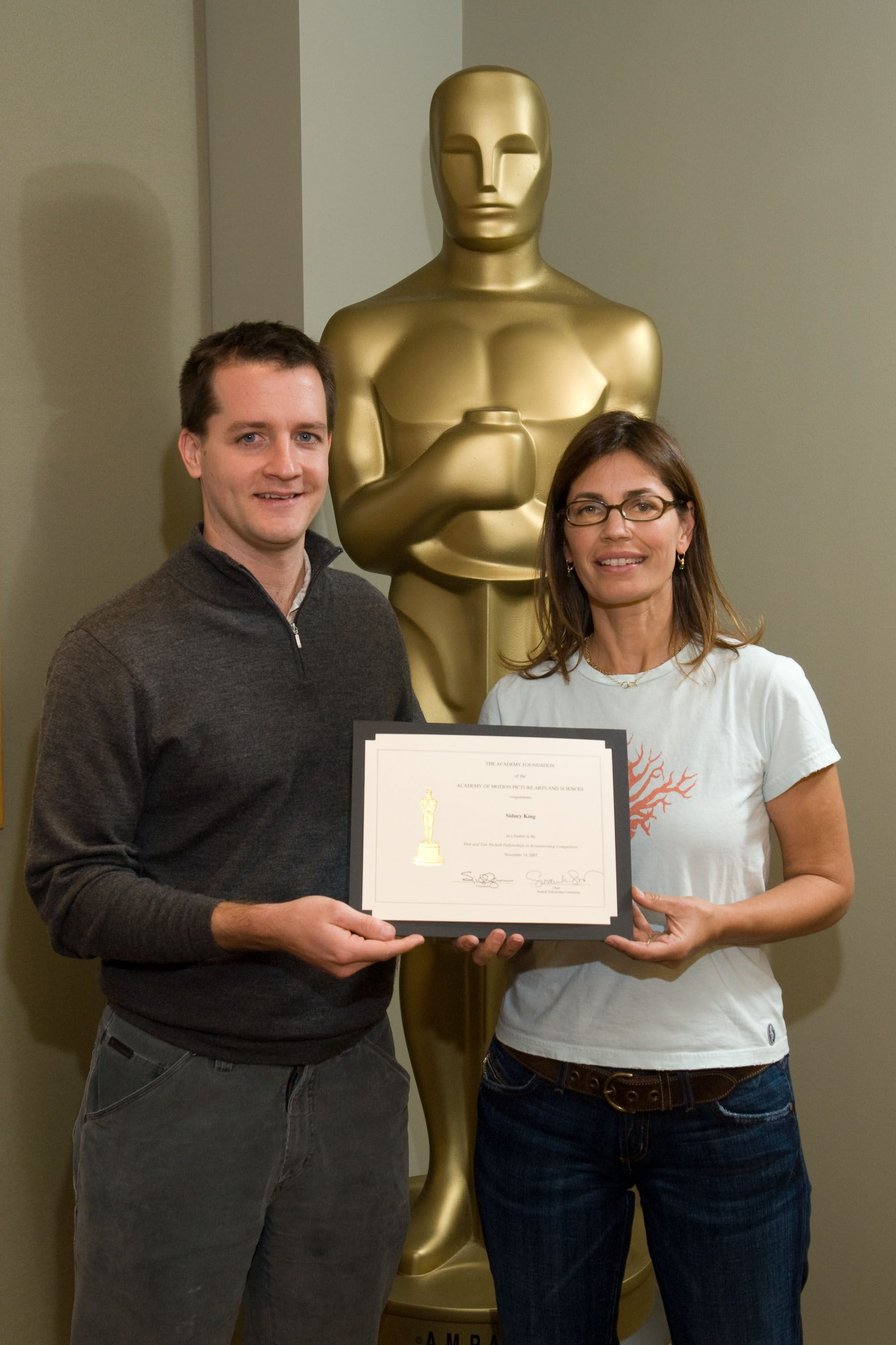 "The Academy of Motion Picture Arts and Sciences' 2007 Nicholl Fellowships in Screenwriting finalists each received a certificate today Sidney King (left), writer of ""Kalona,"" with Oscar-nominated screenwriter Susannah Grant, chair of the Nicholl Committee"