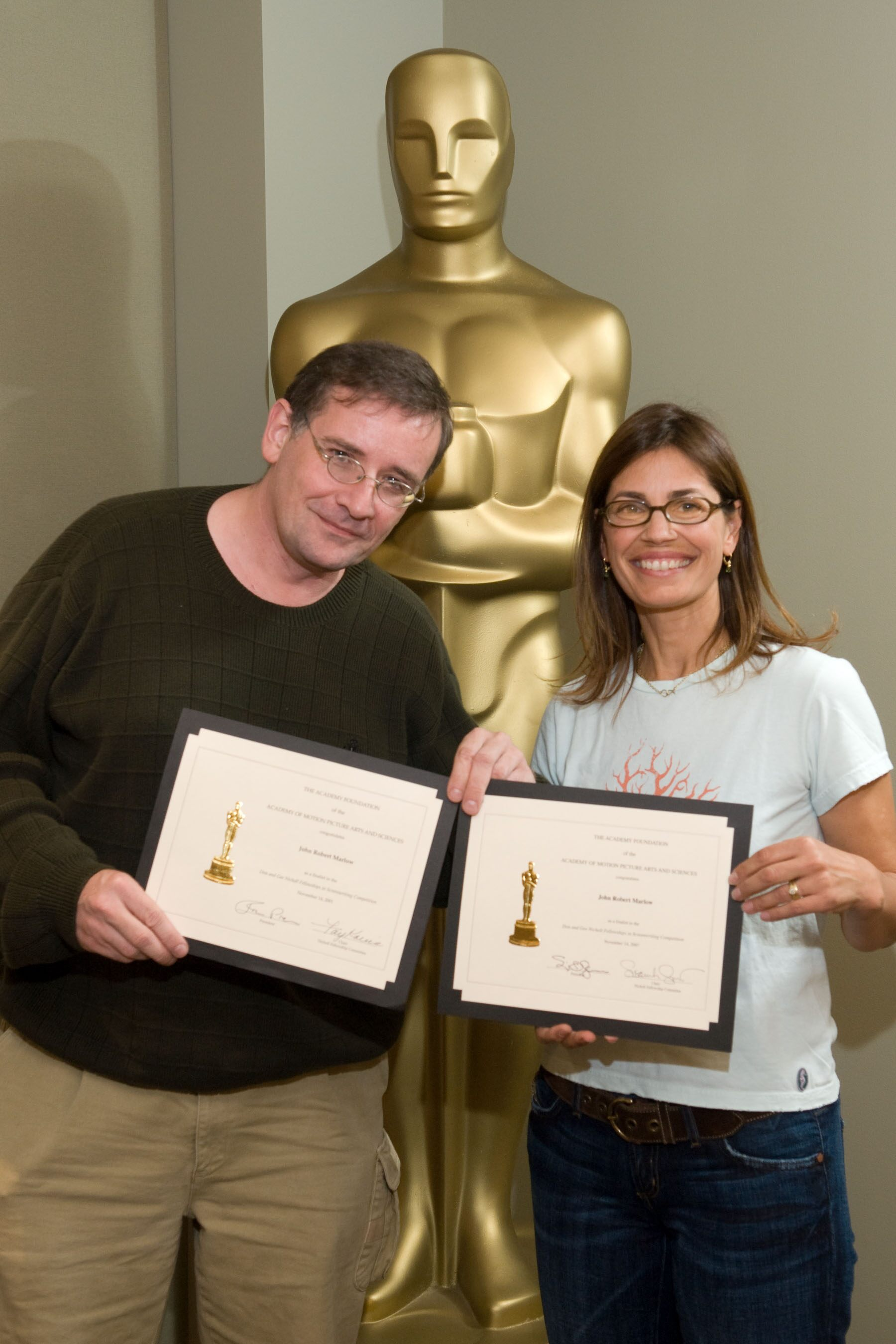 "The Academy of Motion Picture Arts and Sciences' 2007 Nicholl Fellowships in Screenwriting finalists each received a certificate today  John Robert Marlow (left), writer of ""Nano,"" with Oscar-nominated screenwriter Susannah Grant, chair of the Nicholl Com"