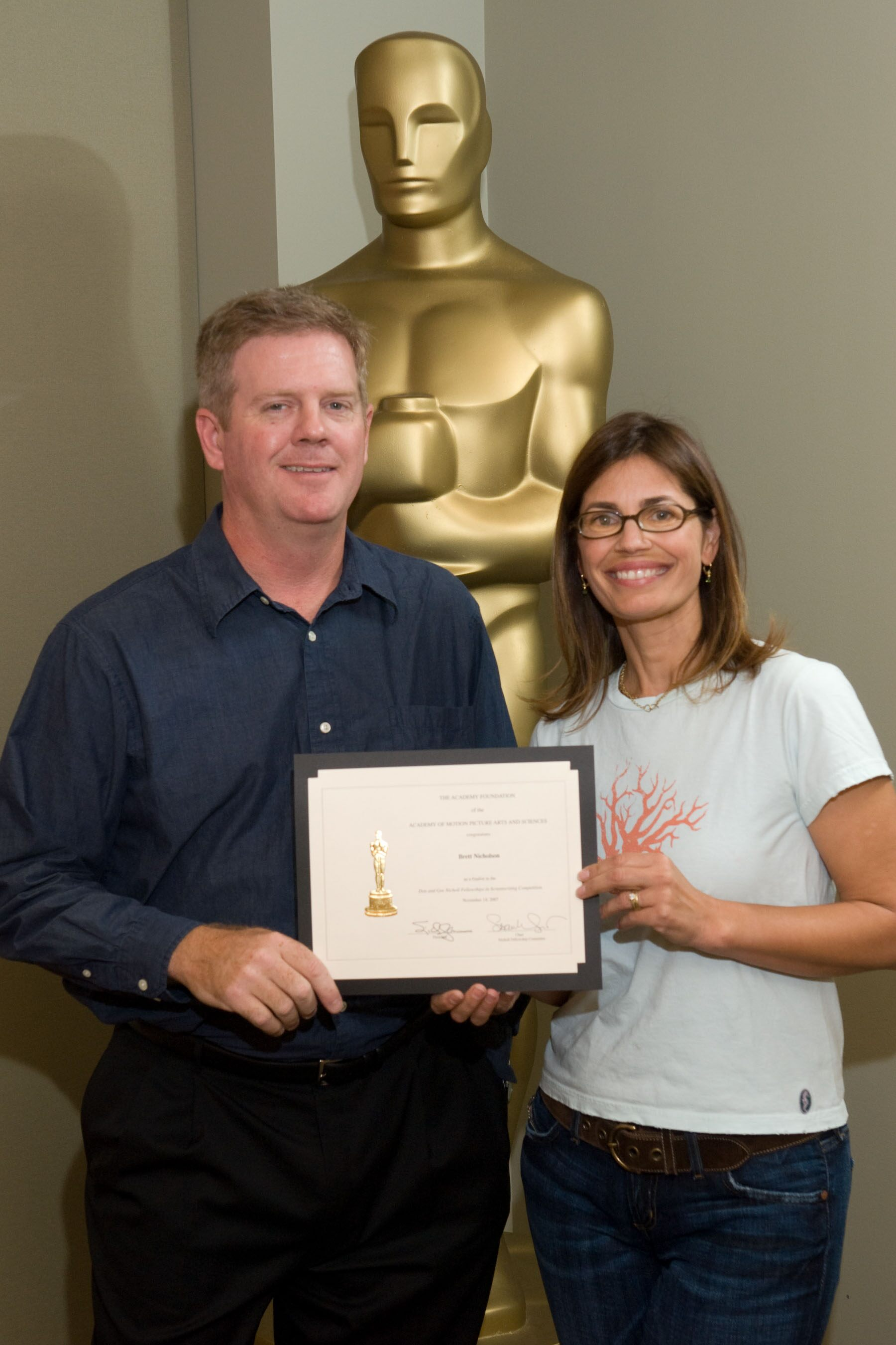 "The Academy of Motion Picture Arts and Sciences' 2007 Nicholl Fellowships in Screenwriting finalists each received a certificate today Brett Nicholson (left), writer of ""Queen of the Sky,"" with Oscar-nominated screenwriter Susannah Grant, chair of the"