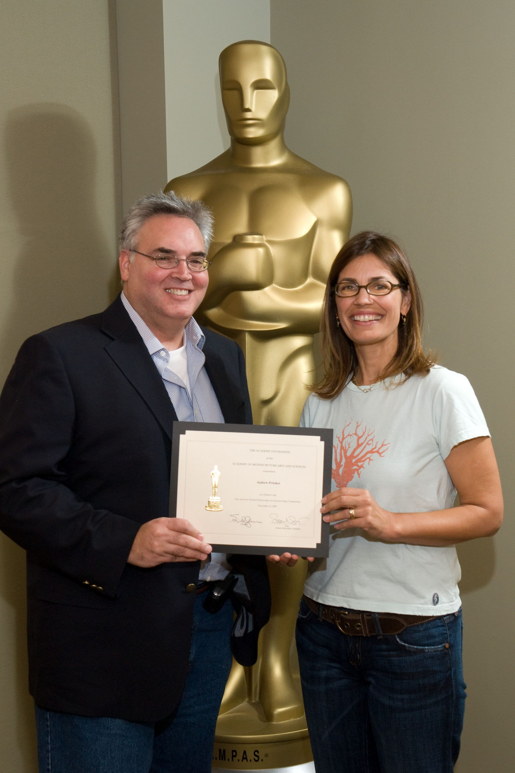 "The Academy of Motion Picture Arts and Sciences' 2007 Nicholl Fellowships in Screenwriting finalists each received a certificate today  Andrew Pritzker (left), writer of ""Sweet in the Saddle,"" with Oscar-nominated screenwriter Susannah Grant."