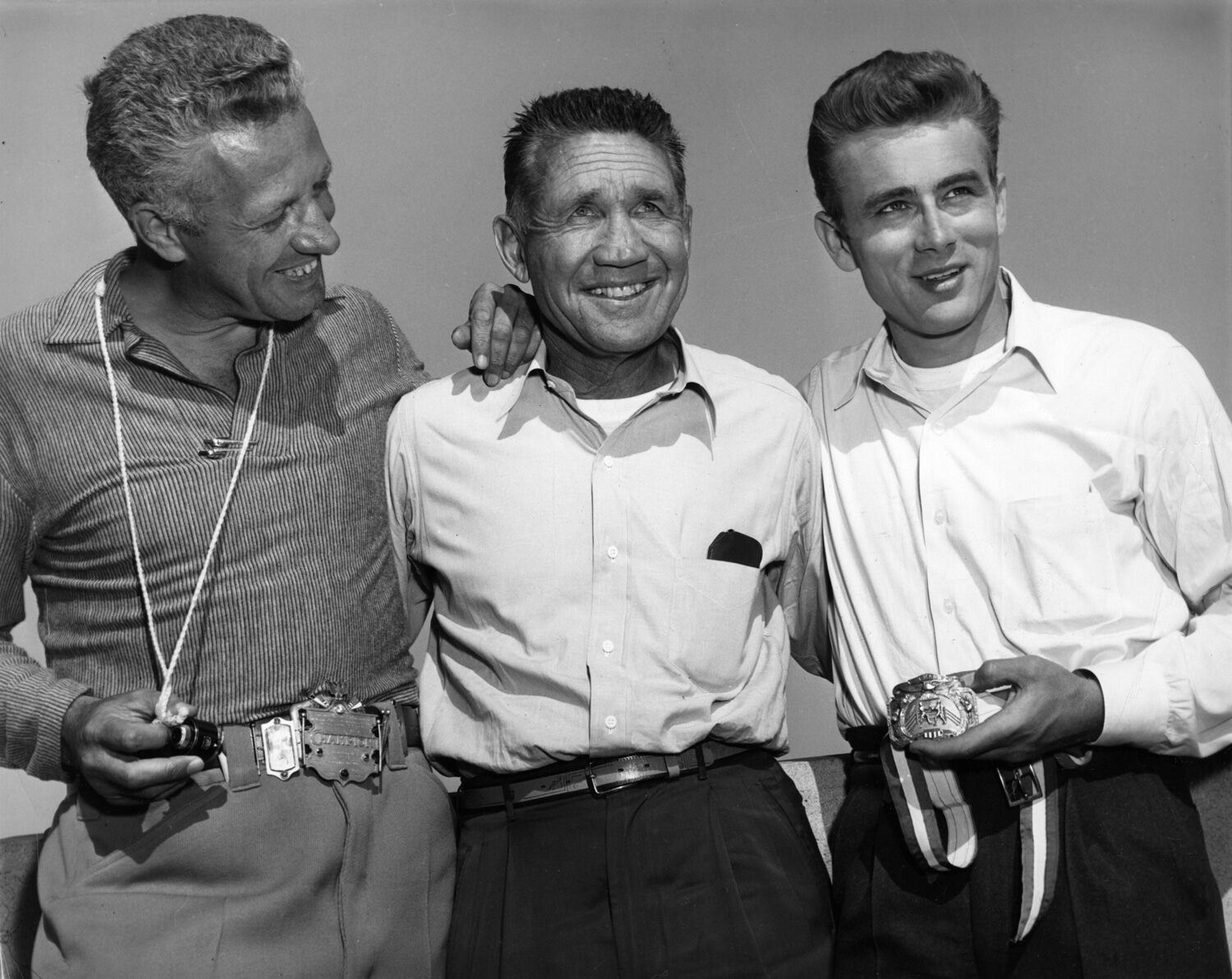 Director Nicholas Ray, boxer and fight consultant Mushy Callahan and James Dean have a laugh while making Rebel without a Cause.