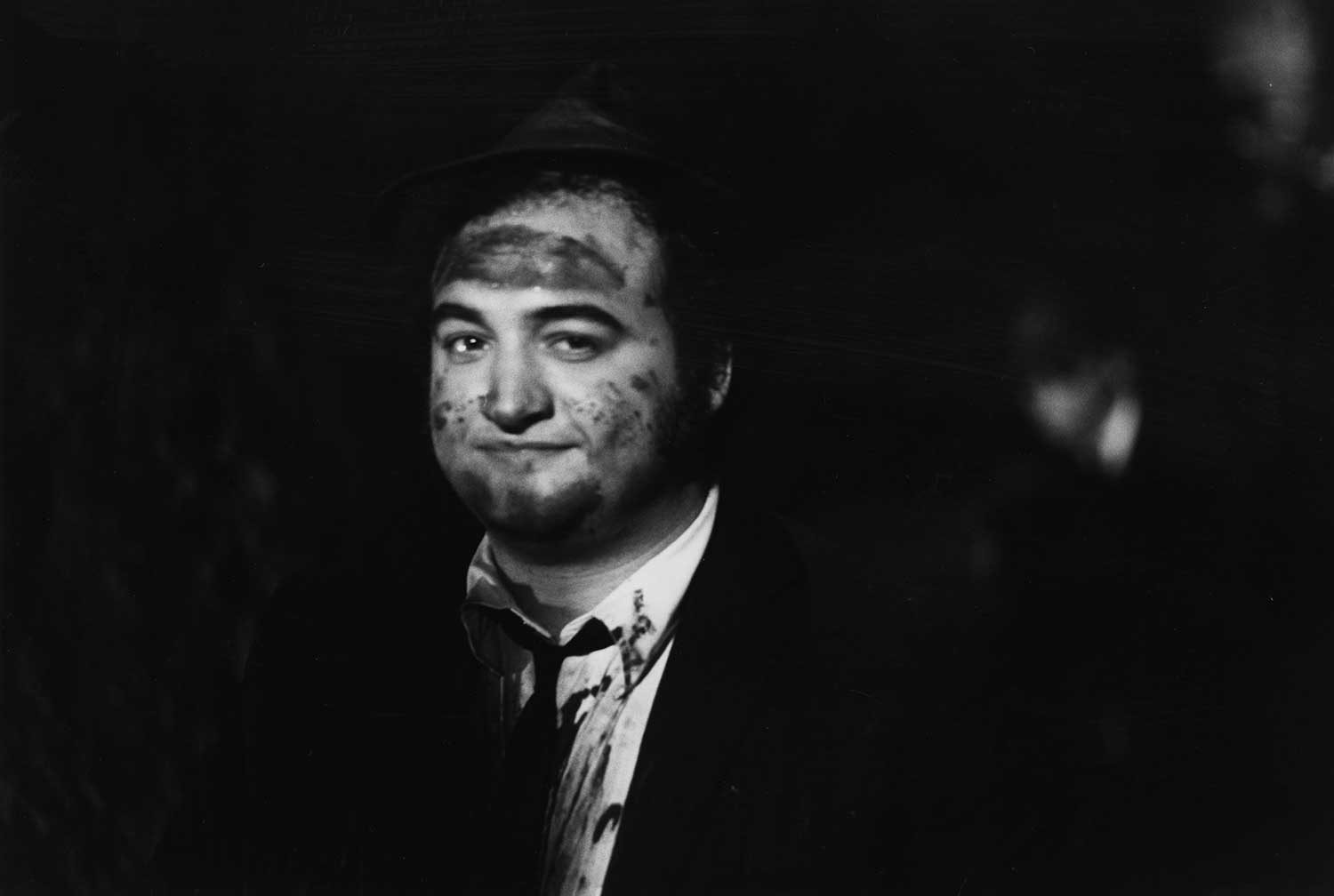 John Belushi takes a break during production of The Blues Brothers, which was mostly filmed in Chicago and made the city a familiar location for many 1980s movies.