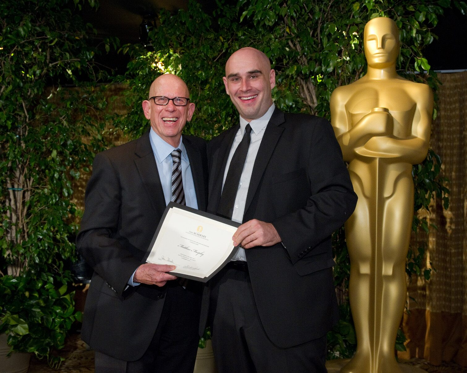 "fellow Matthew Murphy (right), writer of ""Unicorn,"" with Nicholl Committee members Robert Shapiro."