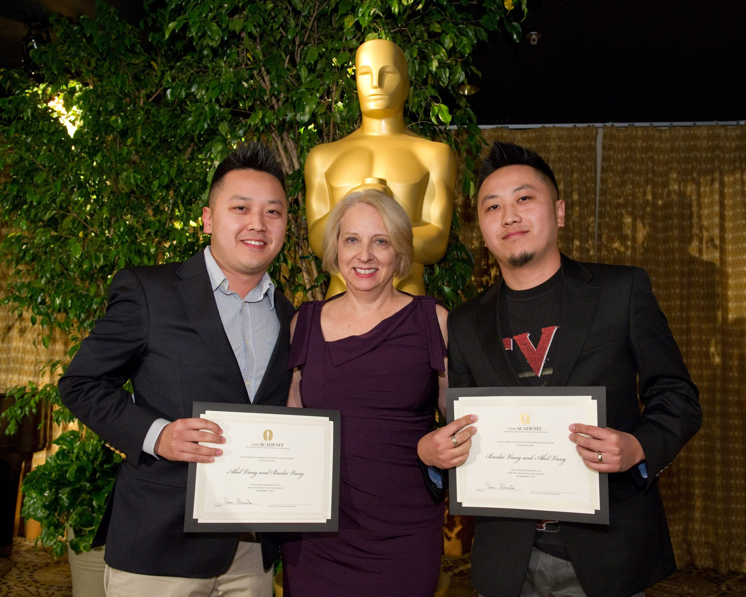 "fellows Abel Vang (left) and Burlee Vang (right), writers of ""The Tiger's Child,"" with Nicholl Committee memb"