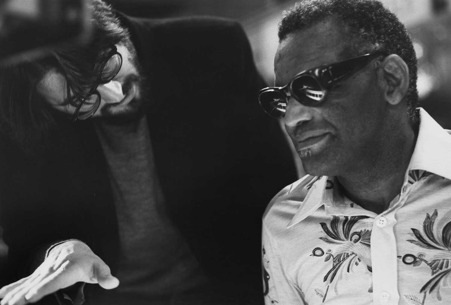 The owner of Ray's Music Exchange in The Blues Brothers is none other than Ray Charles himself, seen here during production with director John Landis.