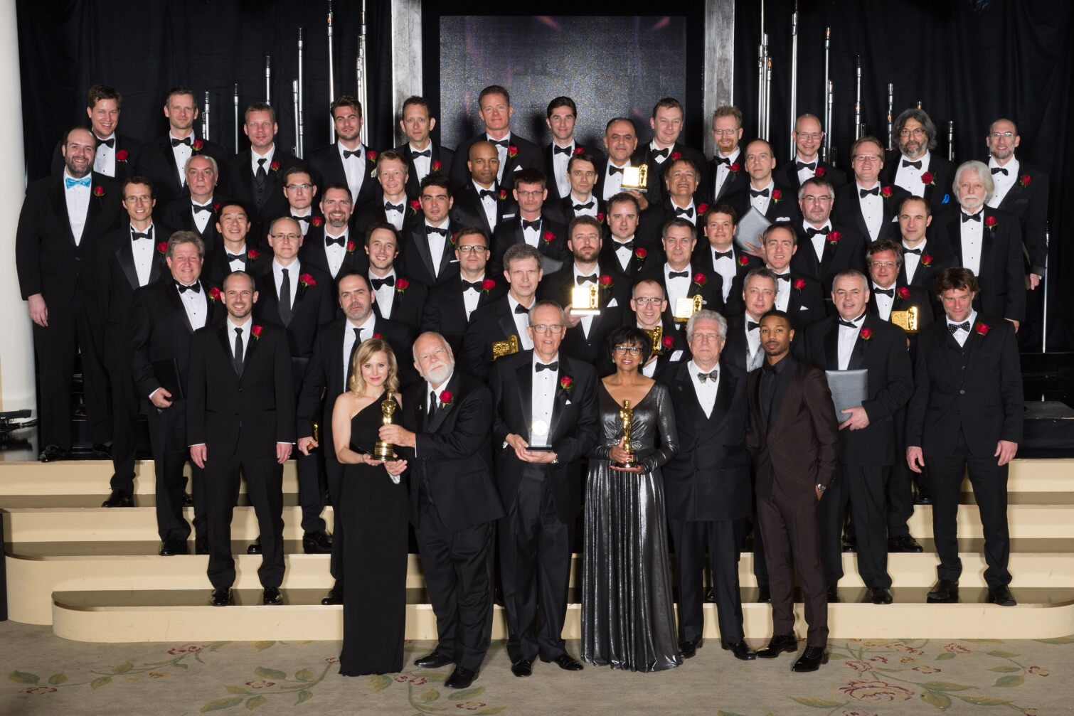 """First row (left to right): Kristen Bell, Peter W. Anderson, Charles ""Tad"" Marburg, Cheryl Boone Isaacs, Richard Edlund and Michael B. Jordan. Second row: Jeremy Selan, Andre Gauthier, Jan Sperling, Etienne Brandt, Gifford Hooper, Philip George and Robert"
