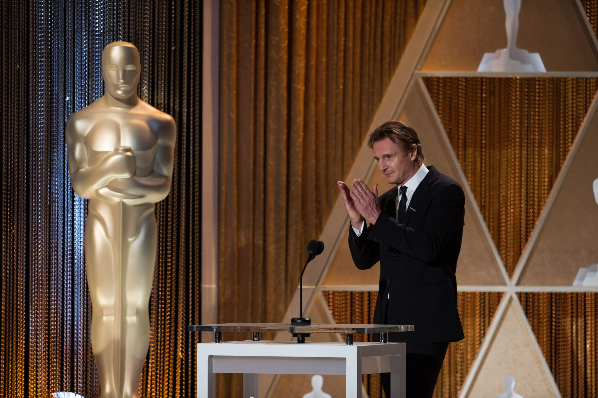 Actor Liam Neeson speaks as part of the award presentation to Honorary Award recipient Maureen O'Hara during the 2014 Governors Awards