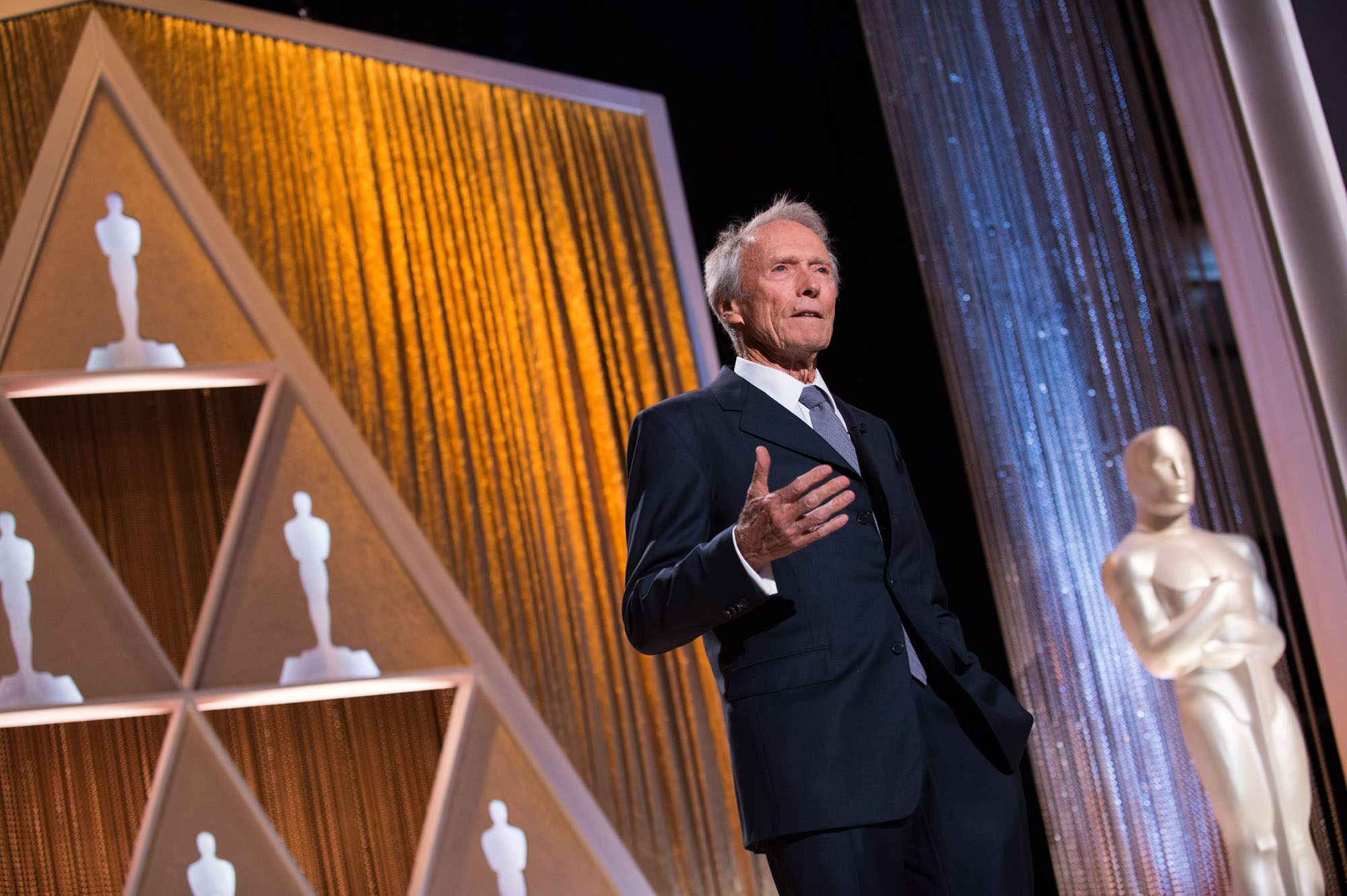 Oscar®-winning actor/director Clint Eastwood speaks as part of the award presentation to Honorary Award recipient Maureen O'Hara during the 2014 Governors Awards