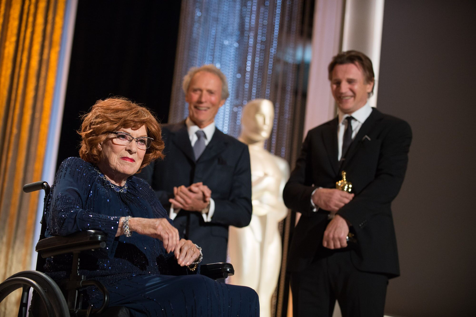 Oscar®-winning actor/director Clint Eastwood (center) and actor Liam Neeson (right) present to Honorary Award to recipient Maureen O'Hara during the 2014 Governors Awards