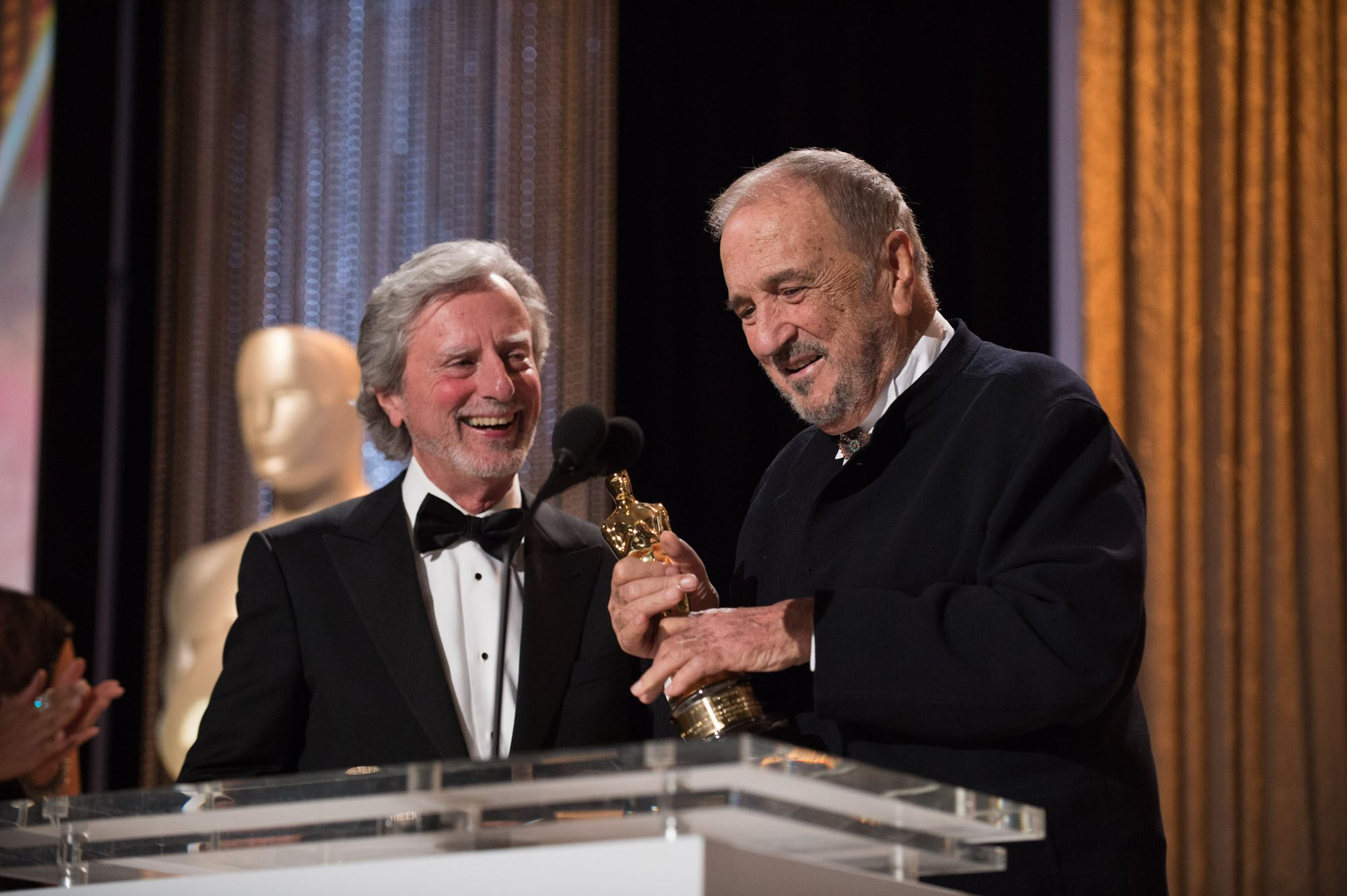 Oscar®-nominated writer Philip Kaufman (left) presents the Honorary Award to recipient Jean-Claude Carrière during the 2014 Governors Awards
