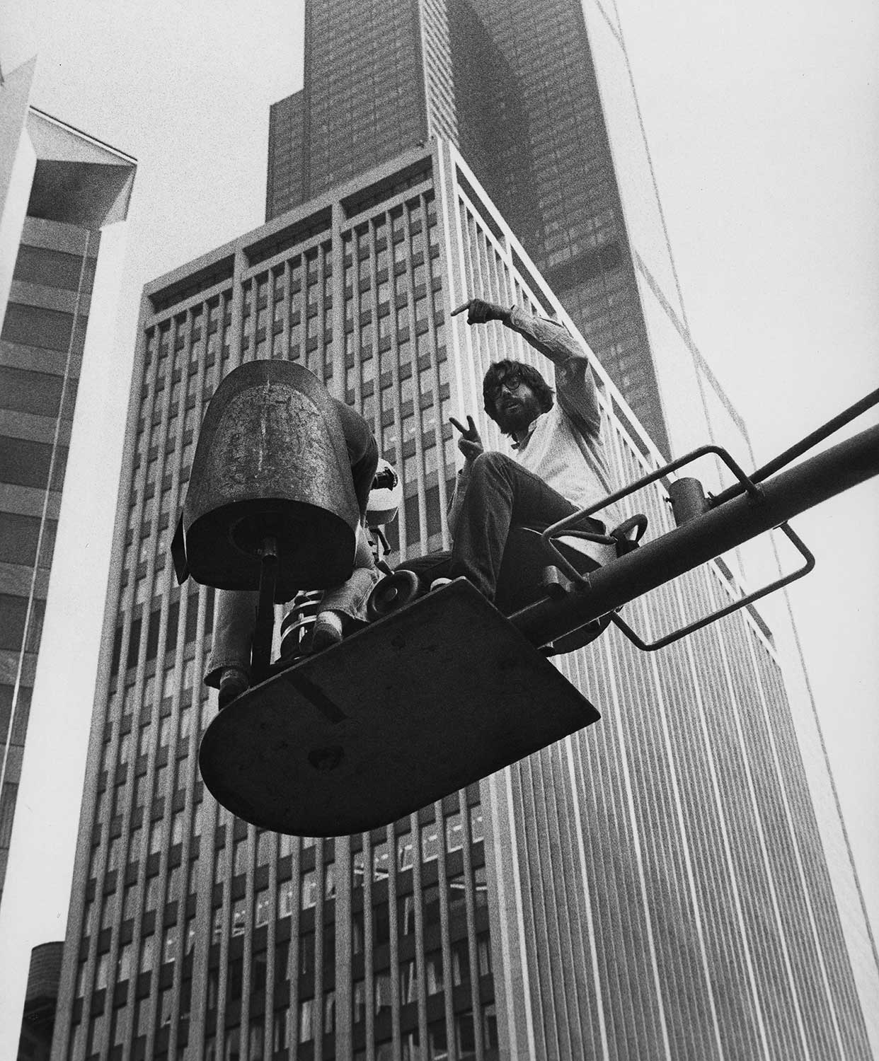 Director John Landis directs a scene from THE BLUES BROTHERS, which involved numerous spectacular sequences including a car crash through the window of the Richard J. Daley Center.