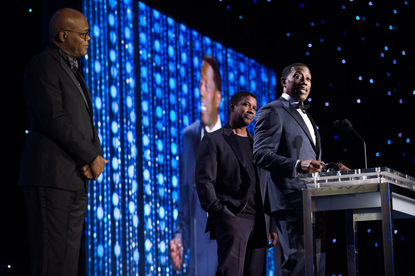 Oscar®-nominated actor Samuel Jackson (left), Oscar®-winning actor Denzel Washington (center) and Wesley Snipes speak as part of the award presentation to Honorary Award recipient Spike Lee at the 2015 Governors Awards