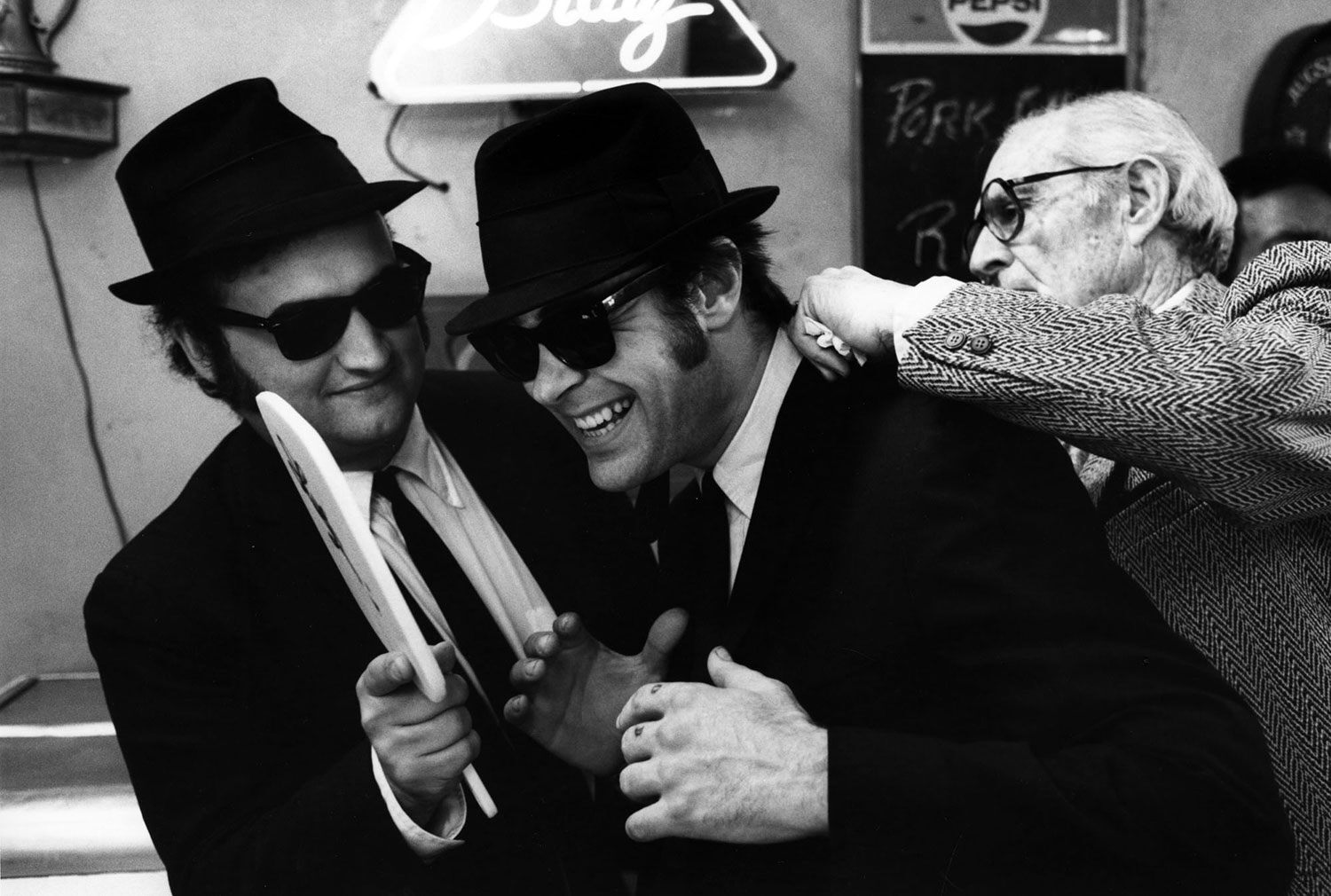 John Belushi and Dan Aykroyd have a laugh during the production of The Blues Brothers, which was shot with the full cooperation of Chicago mayor Jane M. Byrne.