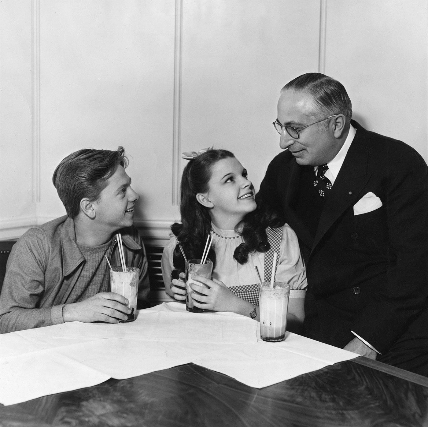 Judy Garland, Mickey Rooney, and studio head Louis B. Mayer