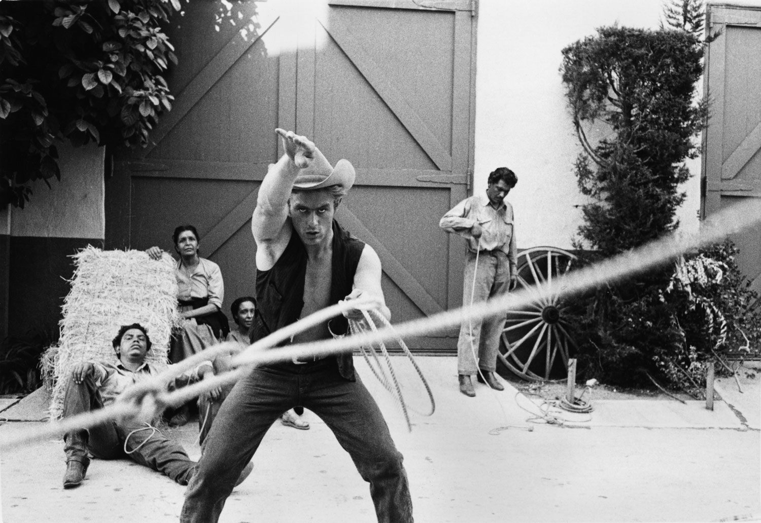 James Dean practices lassoing on the set of Giant, which earned him a Supporting Actor nomination.