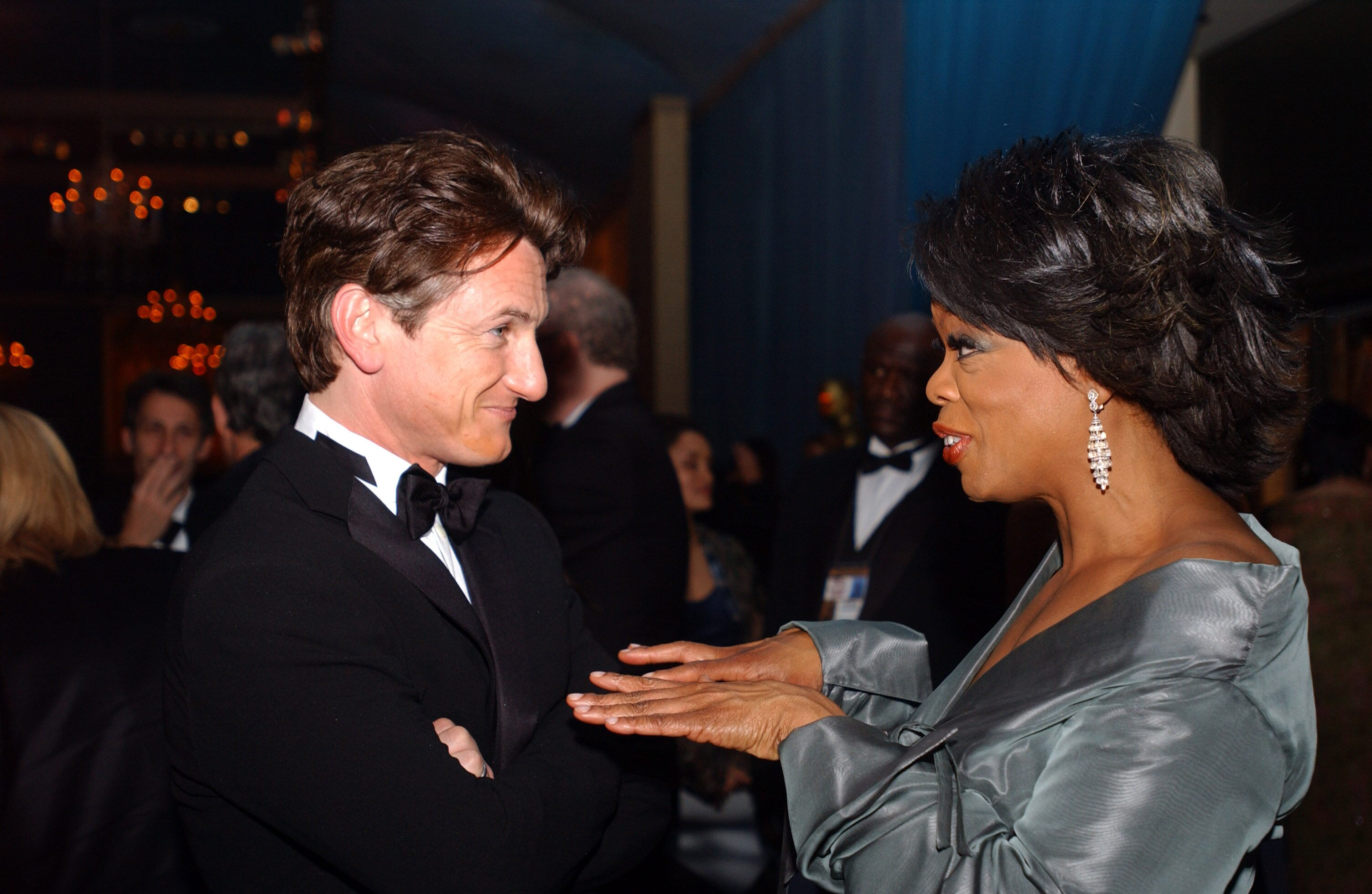 "Sean Penn, Academy Award winner for Best Actor for his work in ""Mystic River,"" chats with Oprah Winfrey at the Governors Ball."