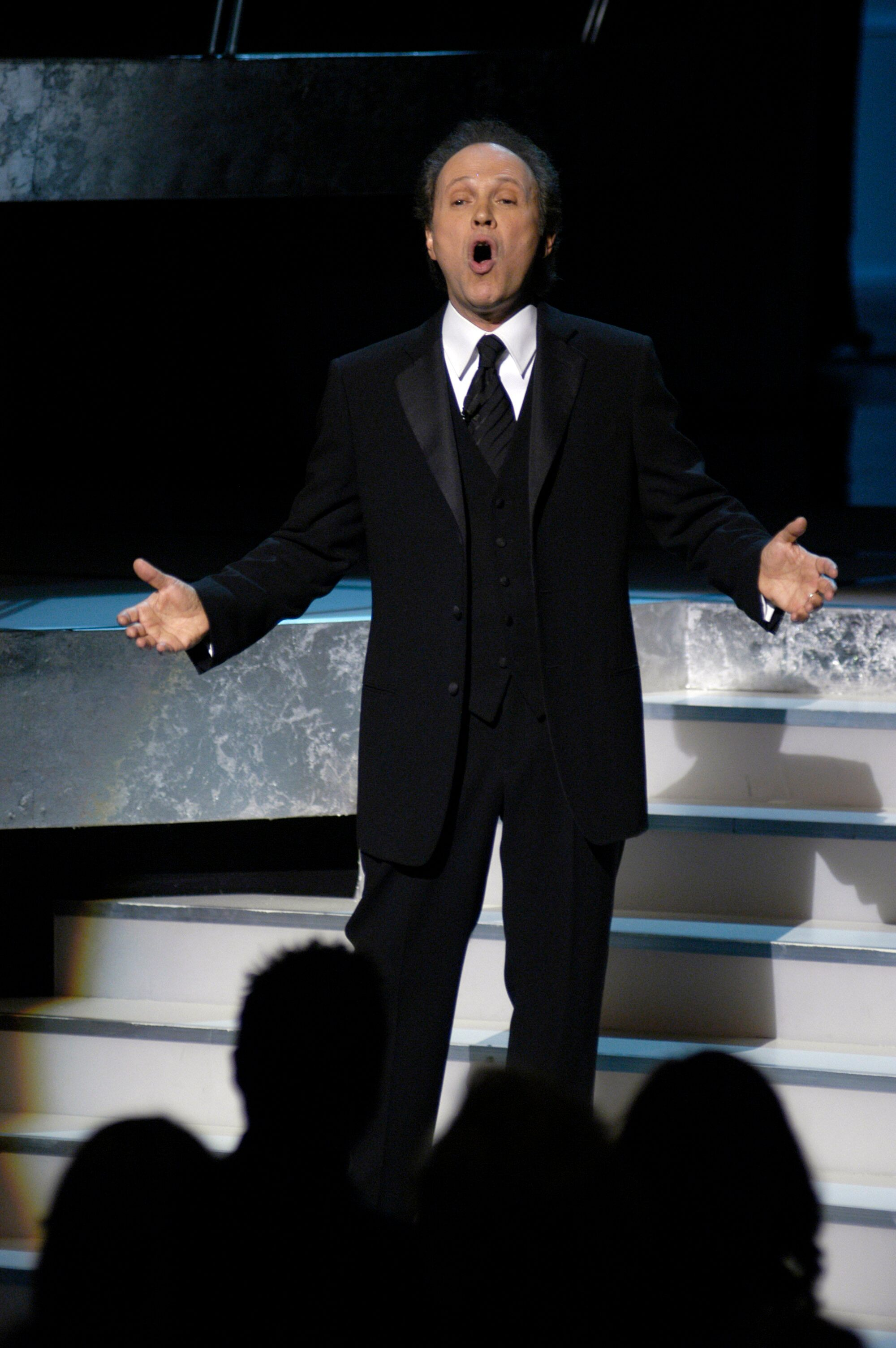 Academy Awards host Billy Crystal performs during the opening.