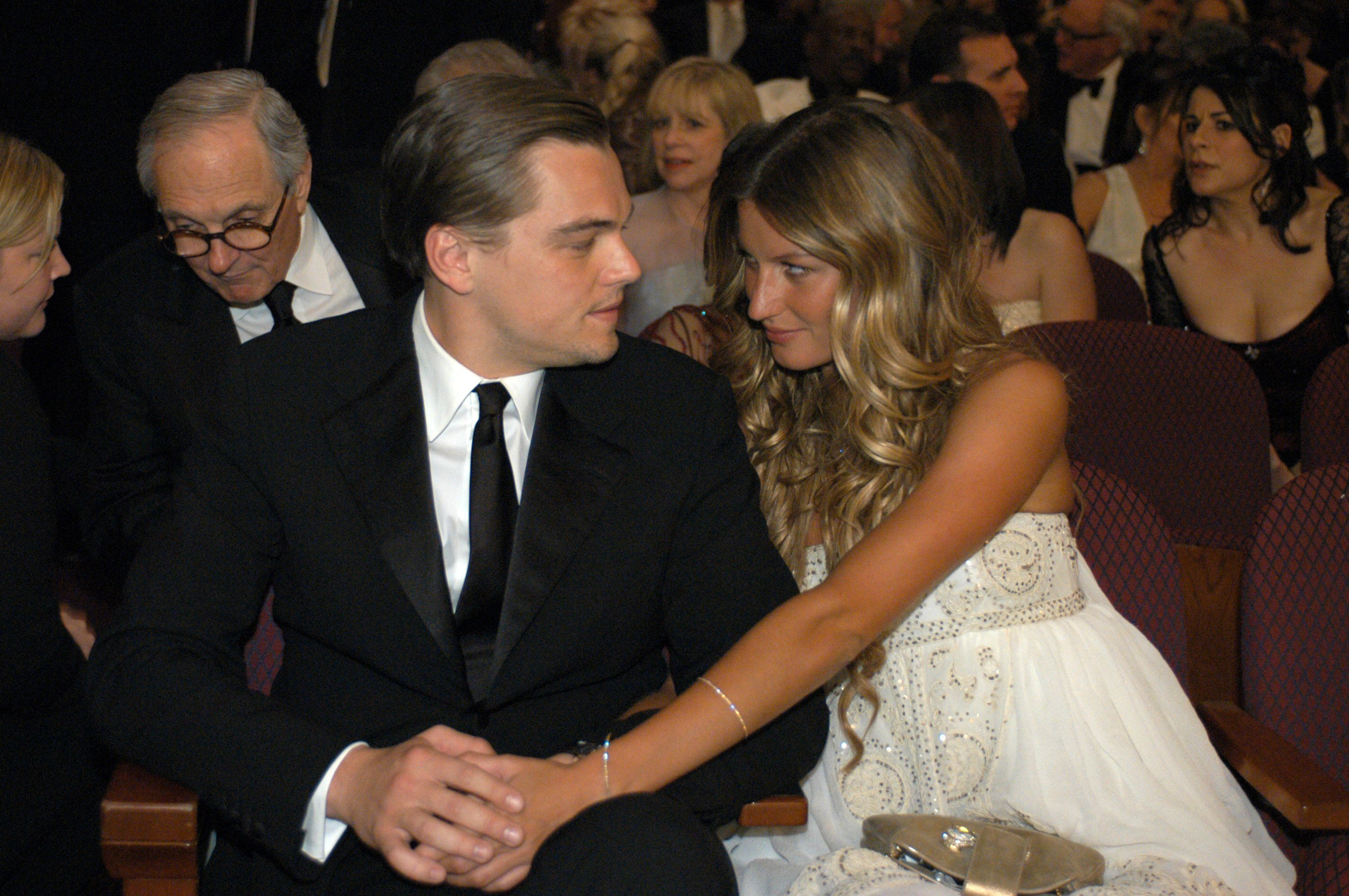 Academy Award Best Actor nominee Leonardo DiCaprio shares a moment with Gisele Bundchen.
