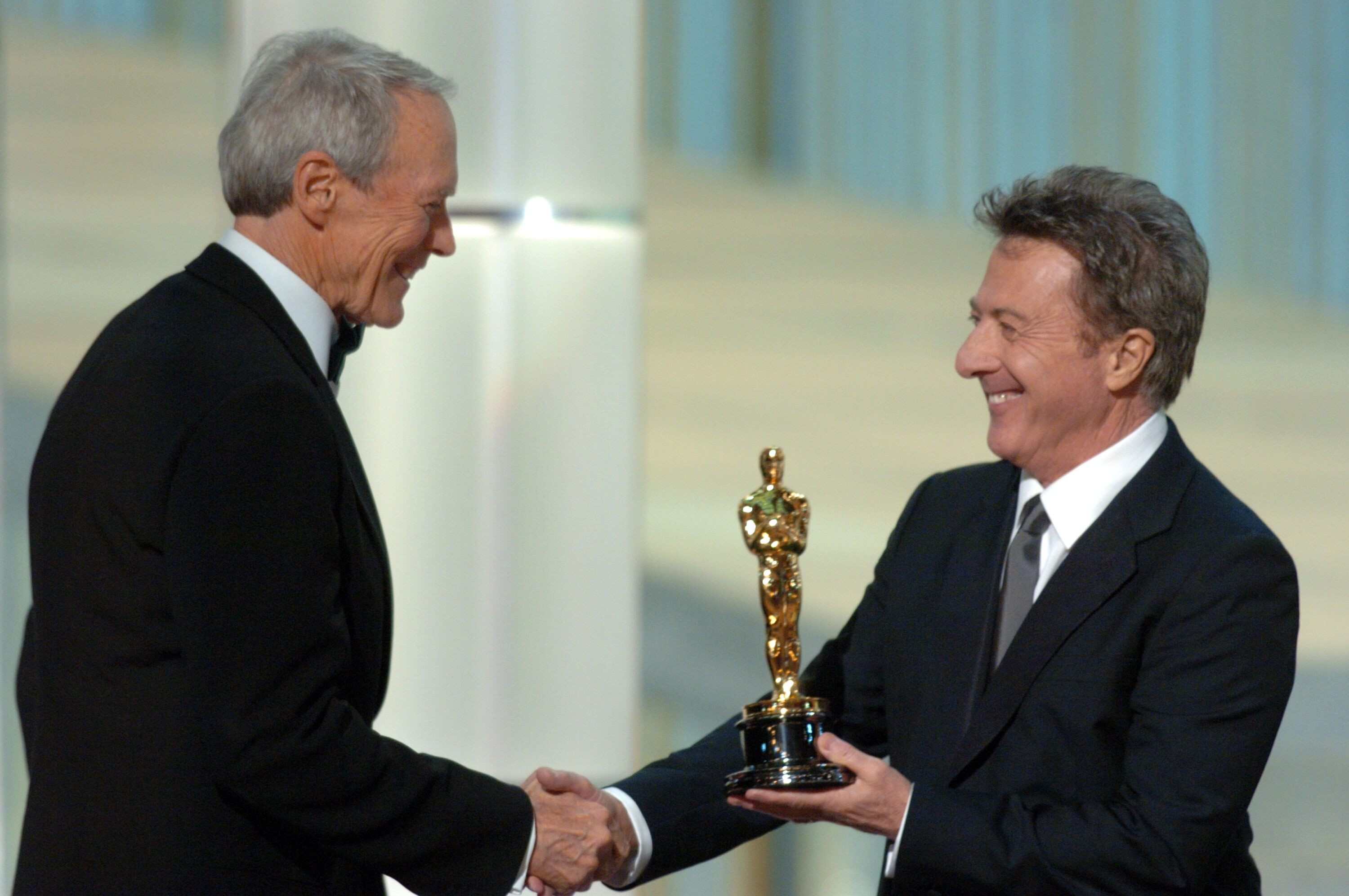 Clint Eastwood accepts the Academy Award for Best Motion Picture from Oscar winner Dustin Hoffman.