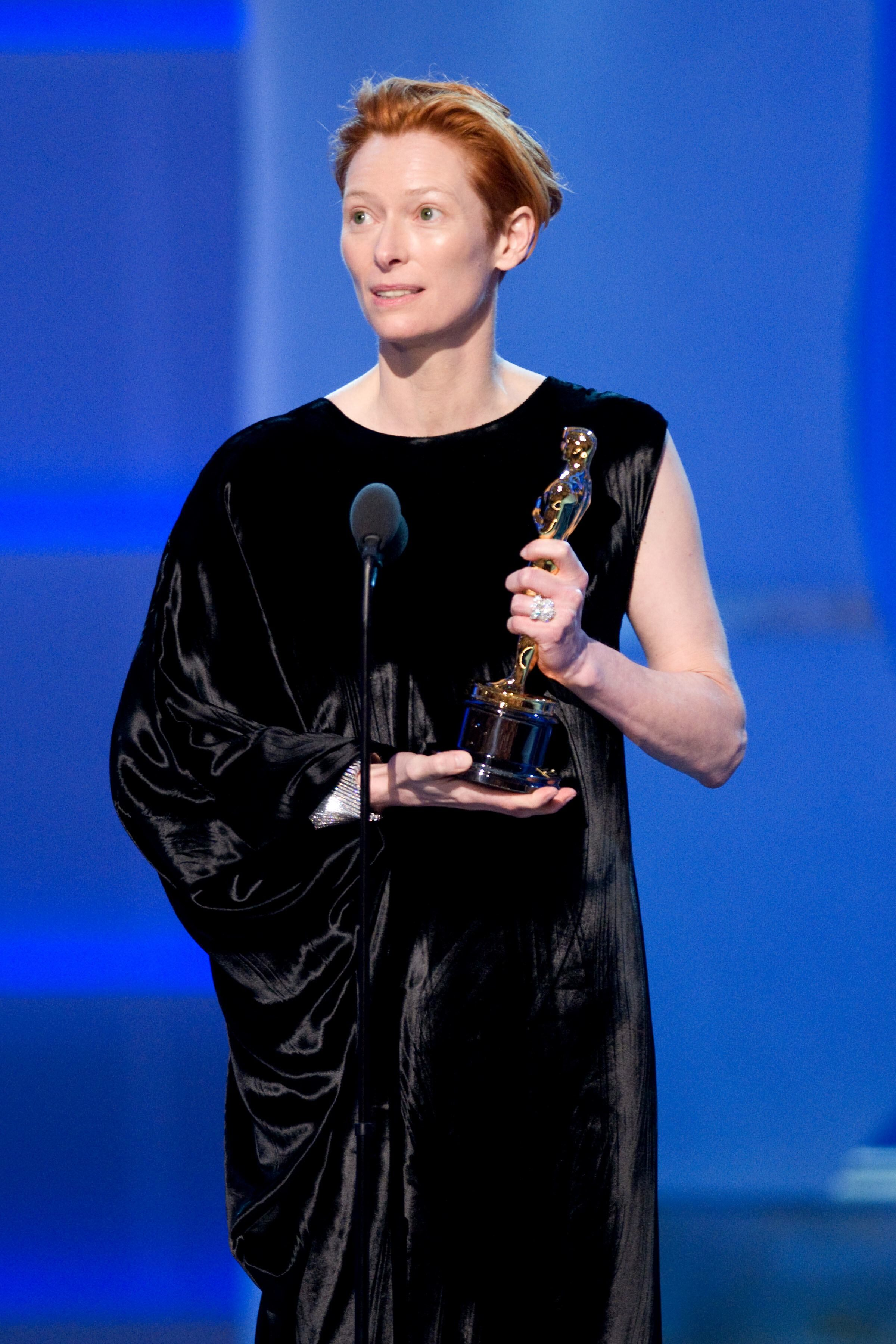 Tilda Swinton accepts the Academy Award for Best Supporting Actress.