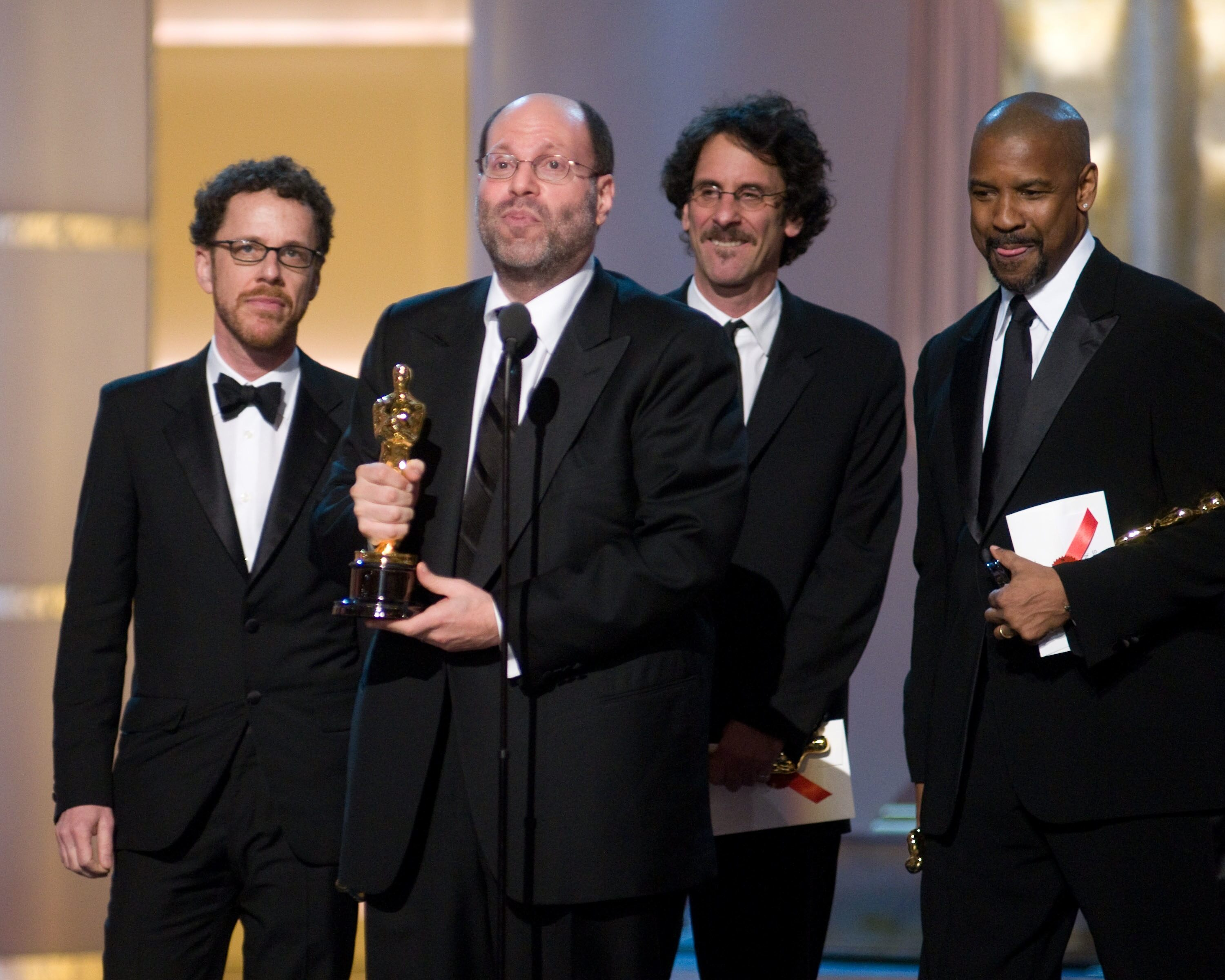 "Joel Coen (far left), Scott Rudin (left), Ethan Coen (right) accept the Academy Award for Best Motion Picture of 2007 for the film ""No Country for Old Men."""