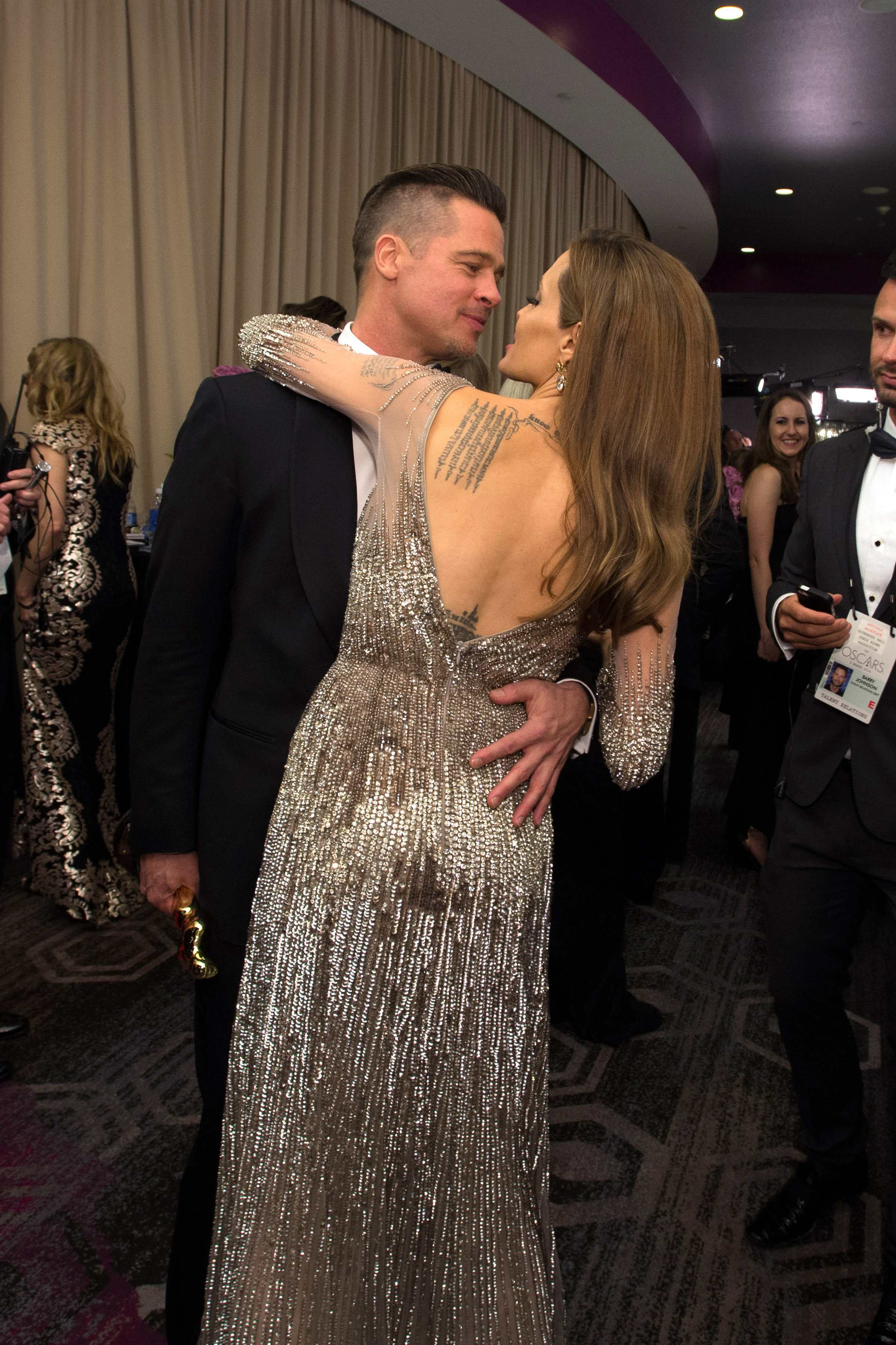 "Oscar® Winner for Best Picture for his work in ""12 Years a Slave"" producer, Brad Pitt and Angelina Jolie celebrate backstage."