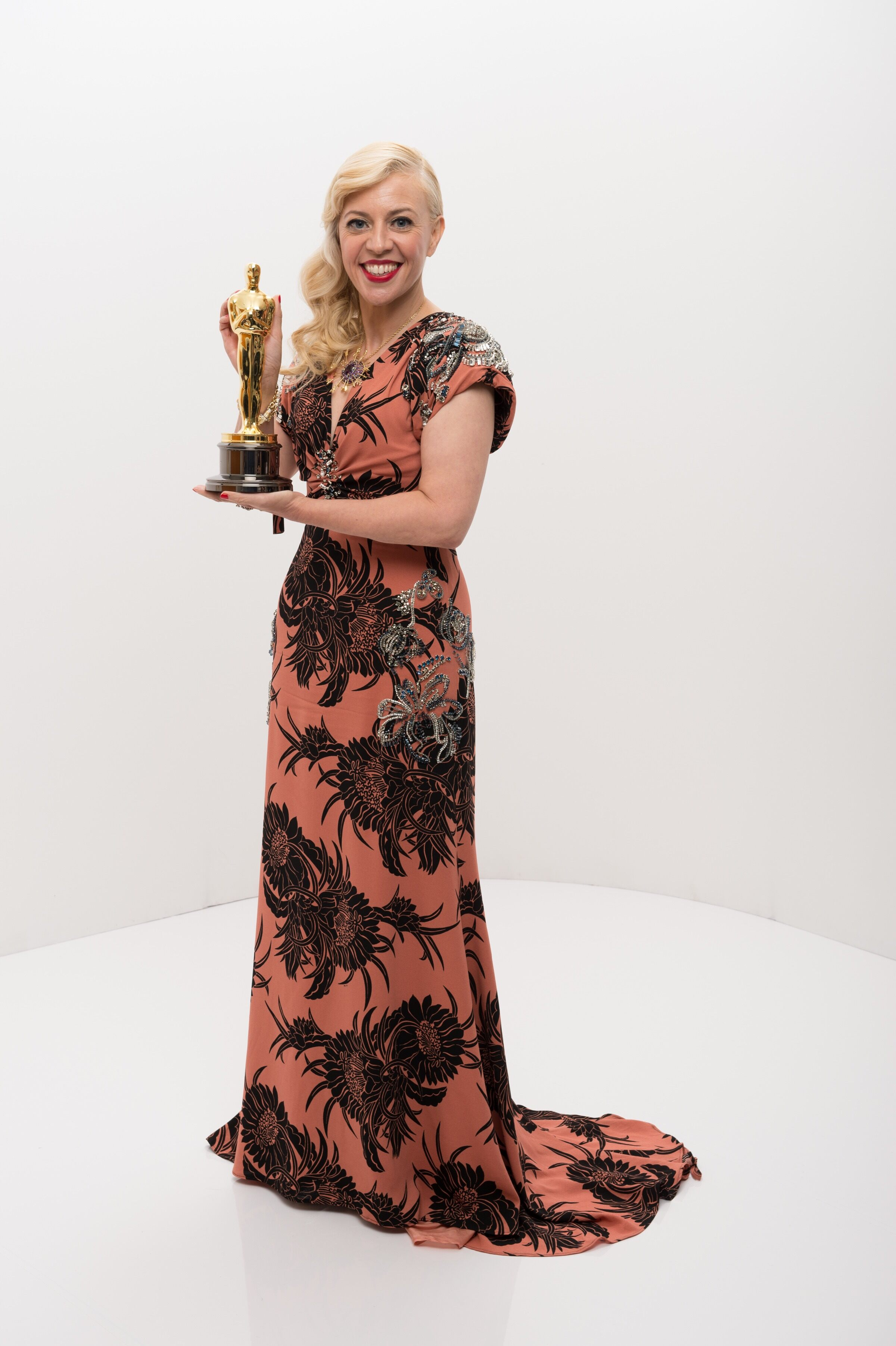 "After winning the Oscar® in the category of Achievement in costume design for work on ""The Great Gatsby,"" Catherine Martin poses with her Oscar®."