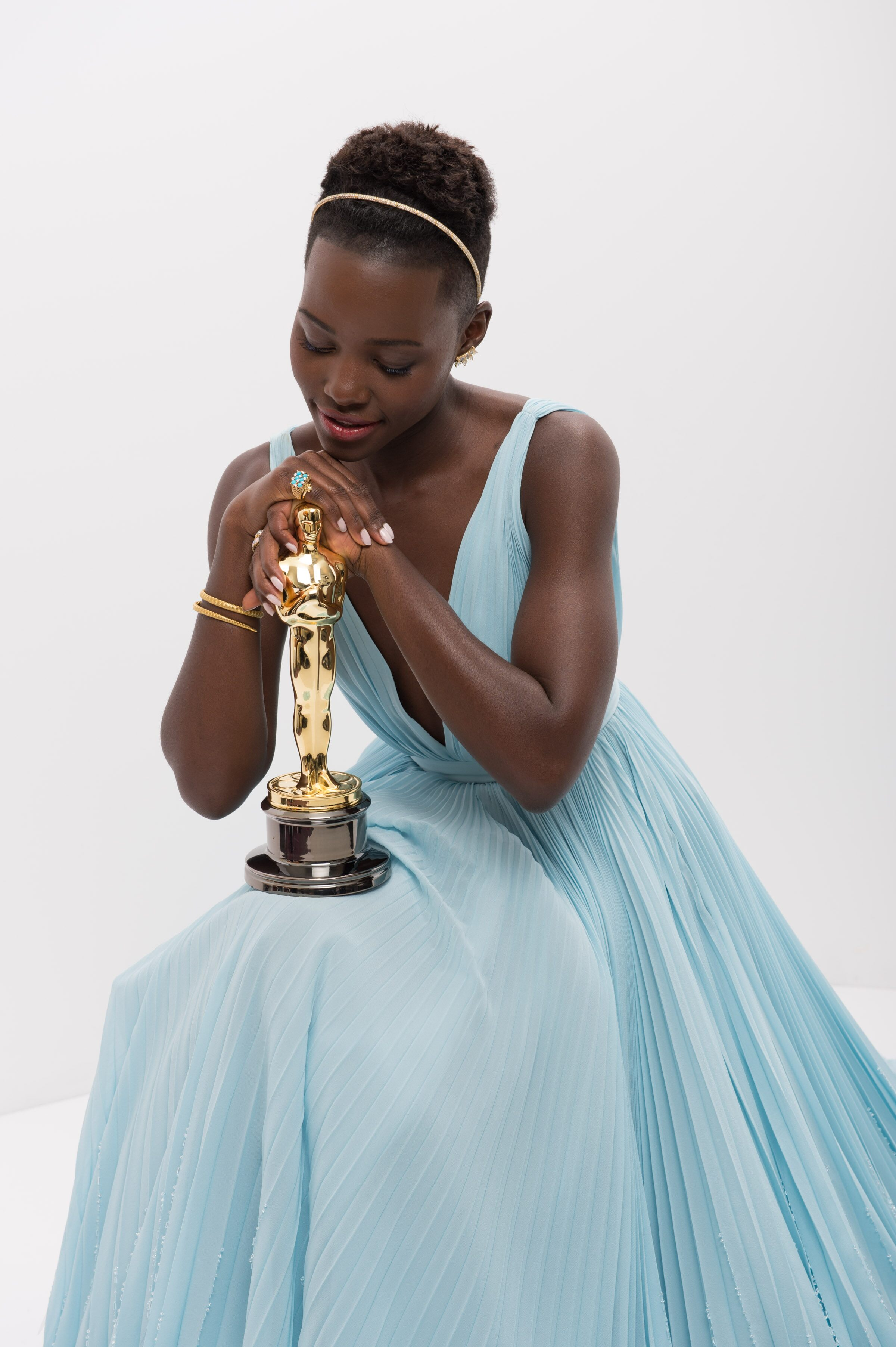 "After winning the category Performance by an actress in a supporting role for her work in ""12 Years a Slave"", actress Lupita Nyong'o poses backstage."