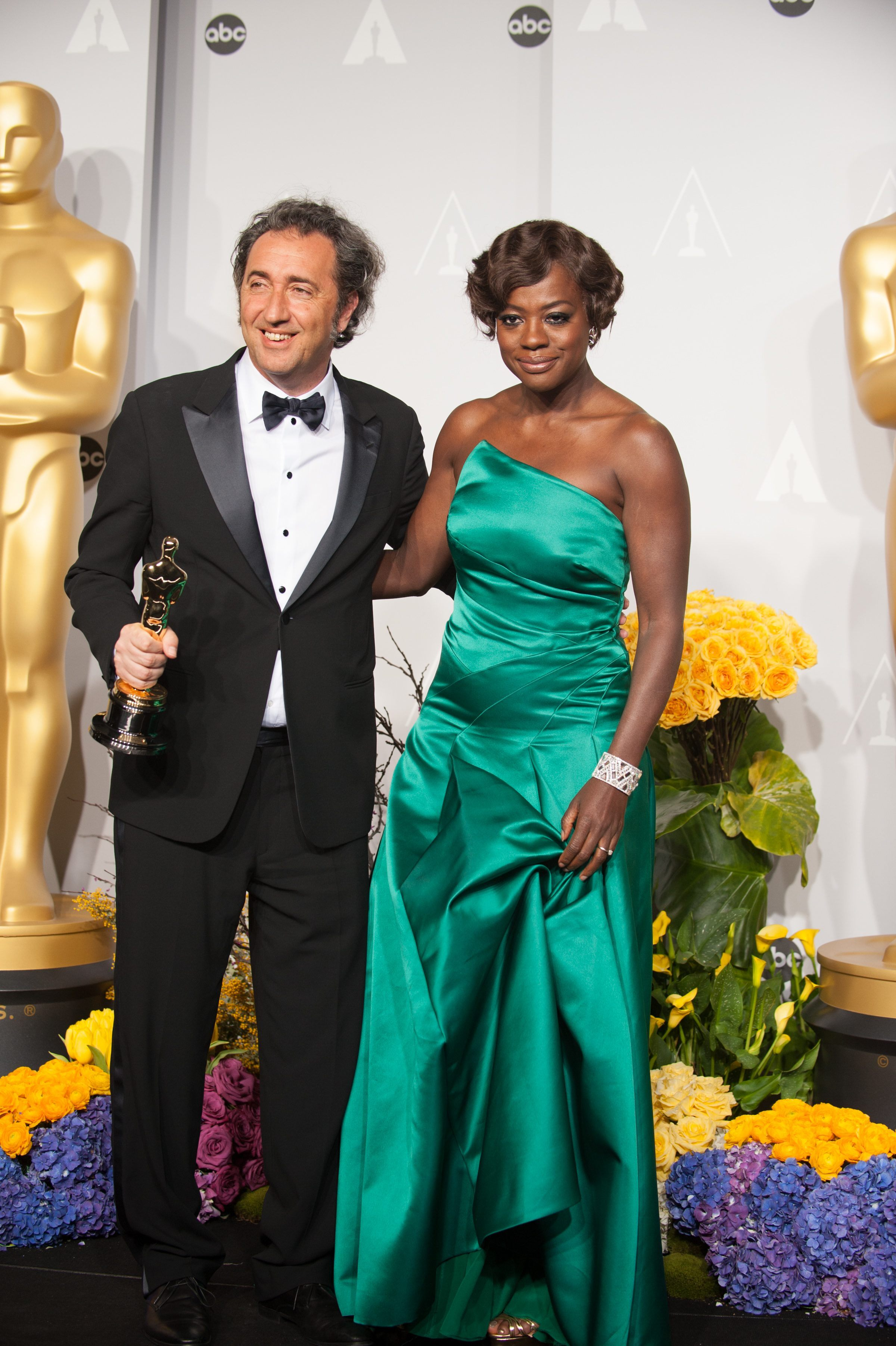 "After winning the category of Best Foreign Language Film of the year for work on ""The Great Beauty,"" Italy, director Paolo Sorrentino poses with his Oscar® and presenter Viola Davis."