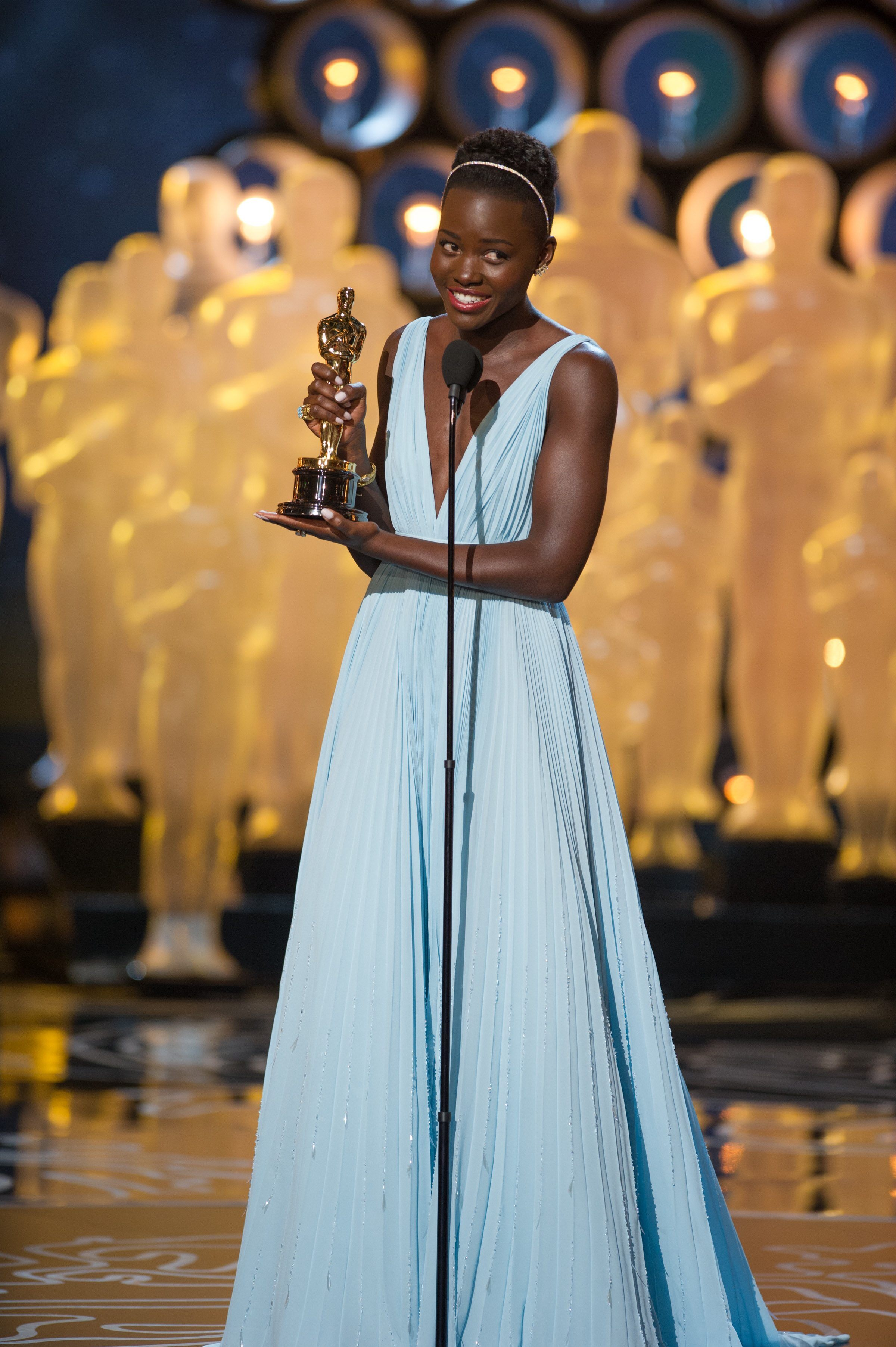 "Lupita Nyong'o accepts the Oscar® for Performance by an actress in a supporting role for her role in ""12 Years a Slave."""