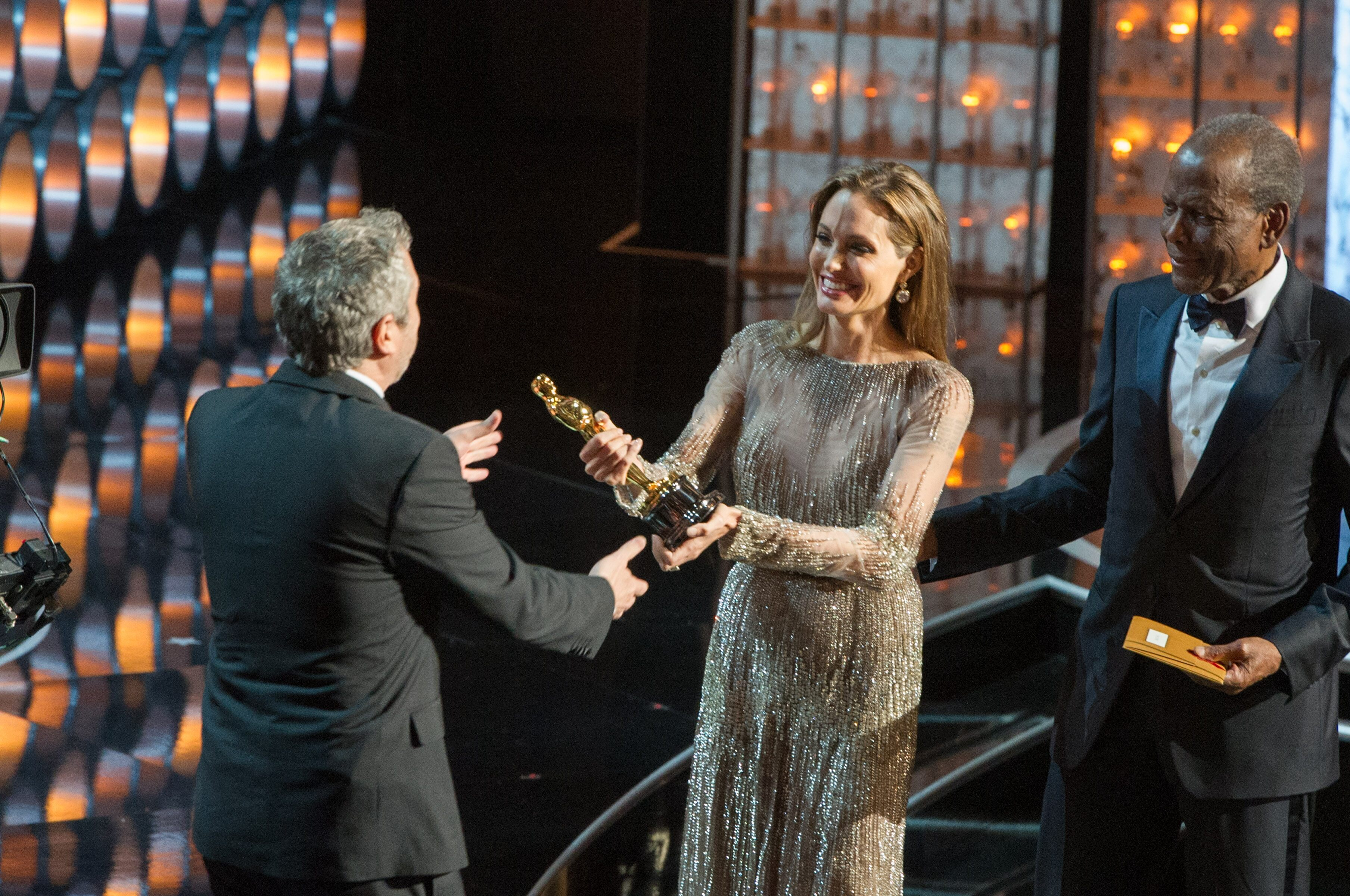 "The Oscar® goes to Alfonso Cuarón for Achievement in Directing for work in ""Gravity"" presented by Angelina Jolie and Sidney Poitier."