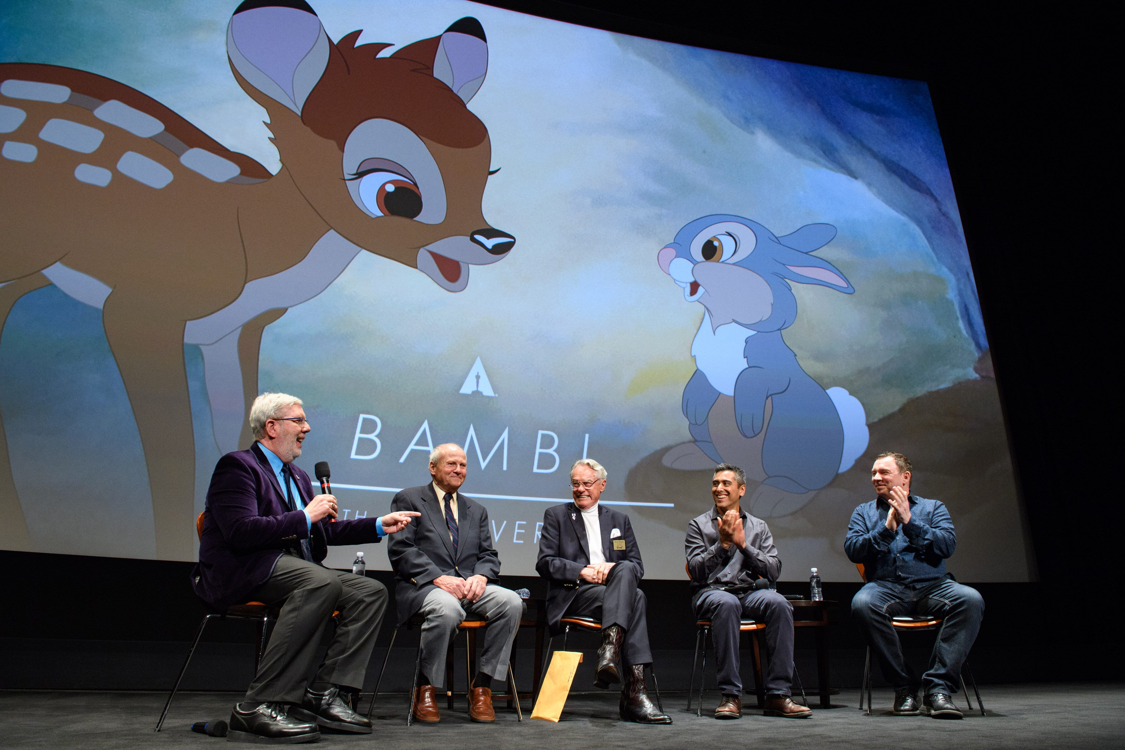 Left to right: host Leonard Maltin, Peter Behn (voice of young Thumper), Donnie Dunagan (voice of young Bambi), Paul Felix (Production Designer at Walt Disney Animation Studios) and Andreas Deja (Disney Legend, Animator)