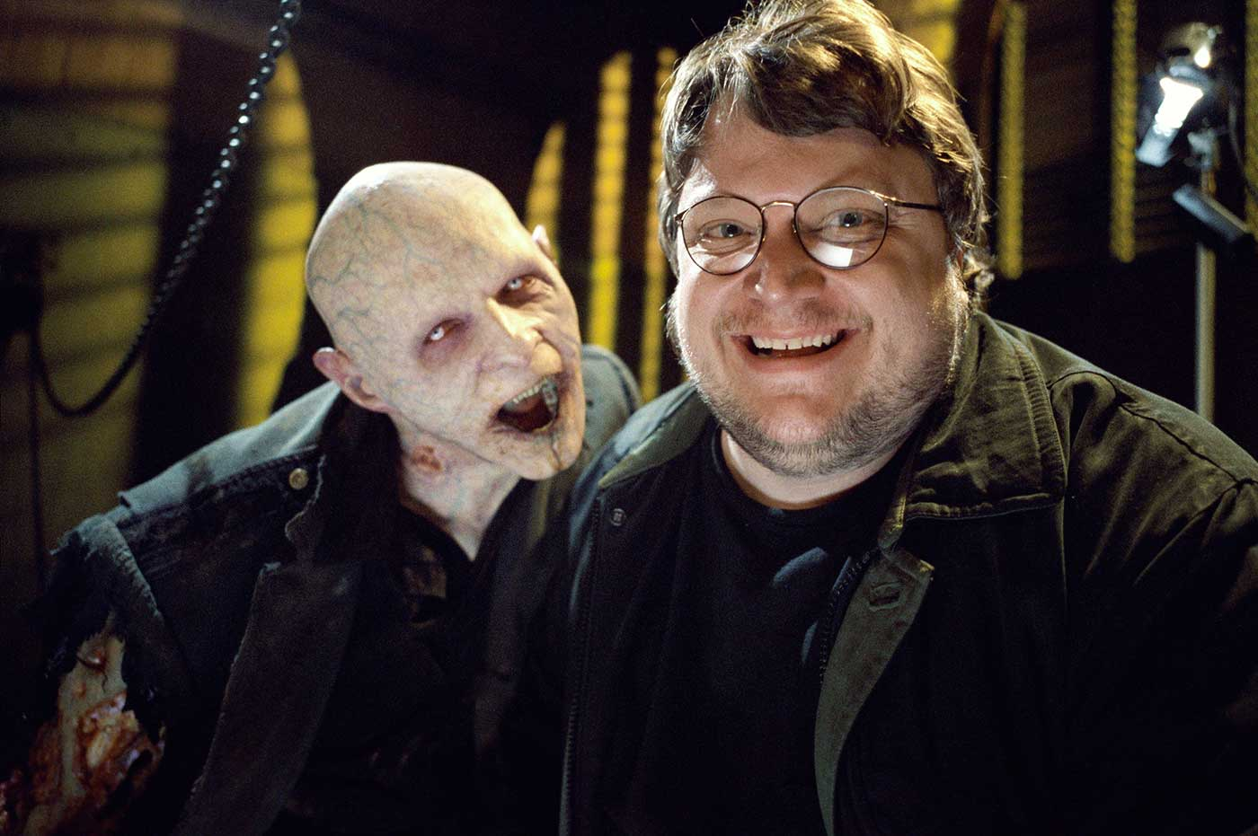 The director feeling right at home behind the scenes with one of the vampiric villains of BLADE II (2002).