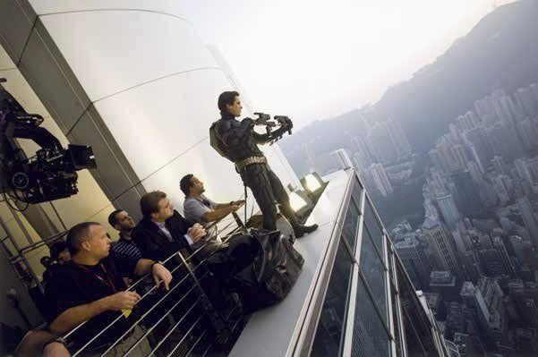 Christian Bale, Christopher Nolan, and others during production on The Dark Knight (2008)
