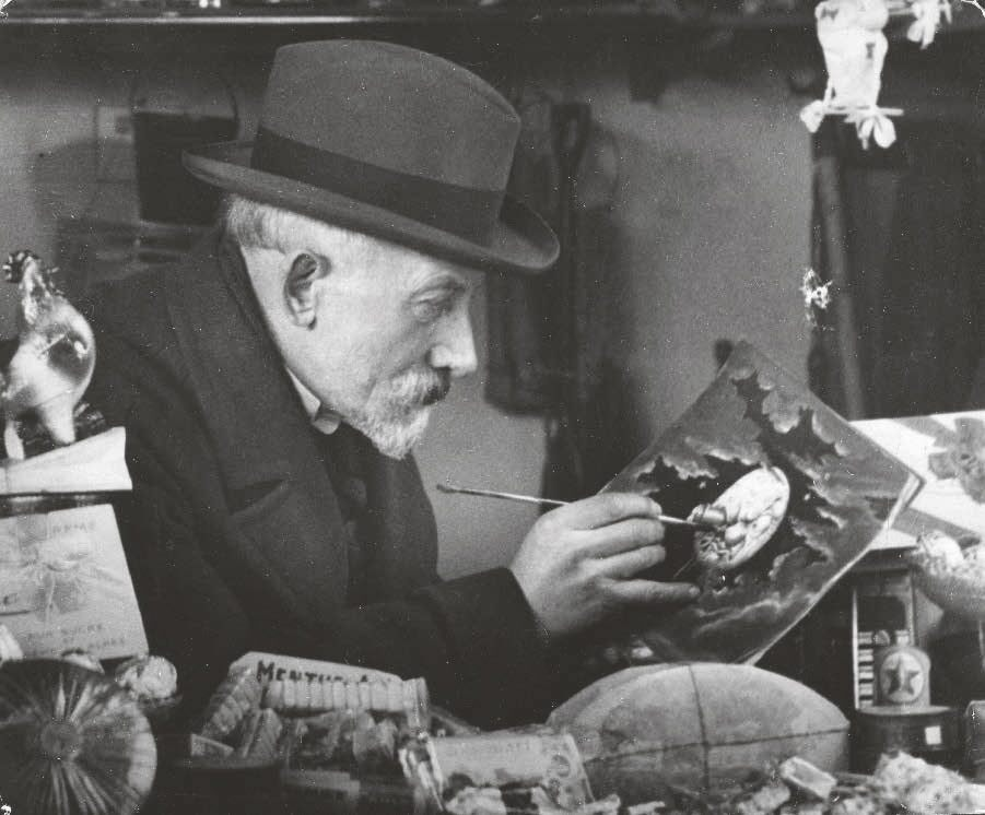 Georges Méliès, ca. 1927, painting an image from his film A Trip to the Moon (1902)