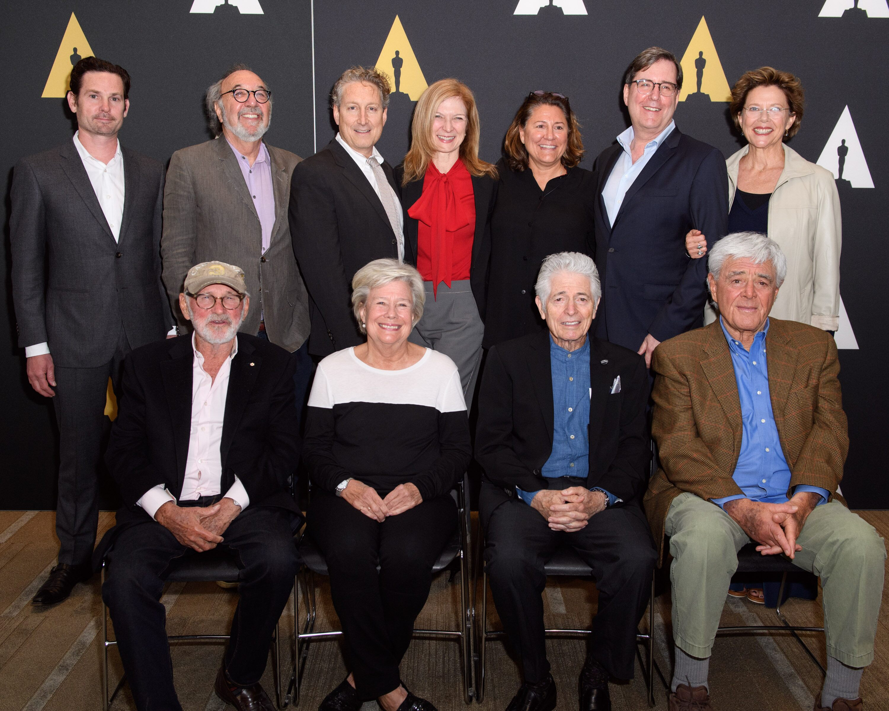 Pictured (left to right): Henry Thomas, Norman Jewison (seated), James L. Brooks, Bernard Telsey, Juliet Taylor (seated), Dawn Hudson, Lora Kennedy, Mike Fenton (seated), David Rubin, Richard Donner (seated) and Annette Bening.