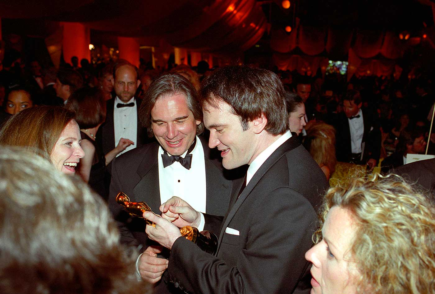 Quentin Tarantino checks out his PULP FICTION Oscar for Original Screenplay at the Governors Awards following the Oscars in 1996. He won again in the same category for DJANGO UNCHAINED in 2013.