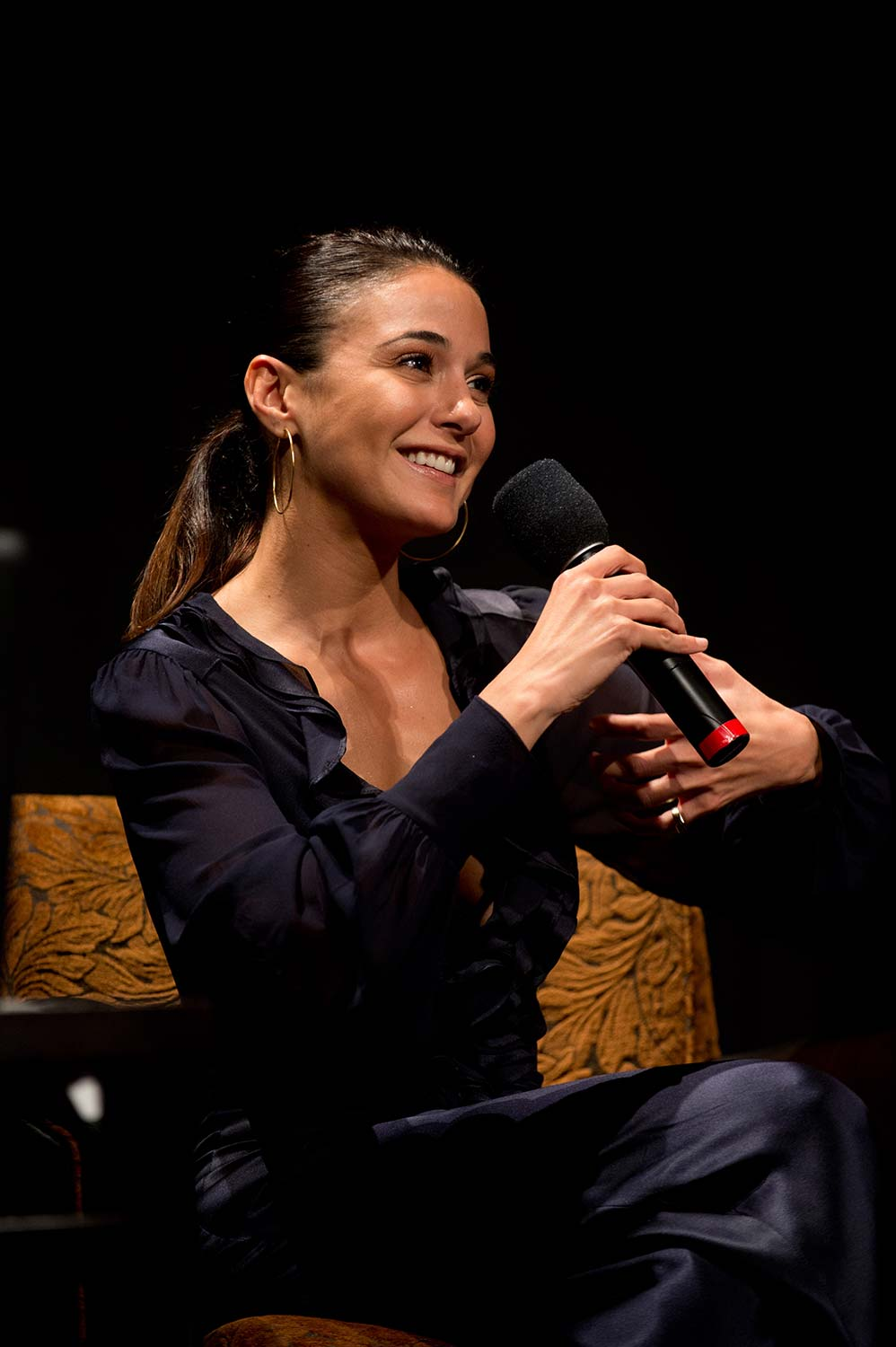 Actress Emmanuelle Chriqui onstage.