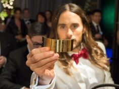 Oscar®-winner Jared Leto shows off his newly engraved plaque at the engraving station at the Governor's Ball