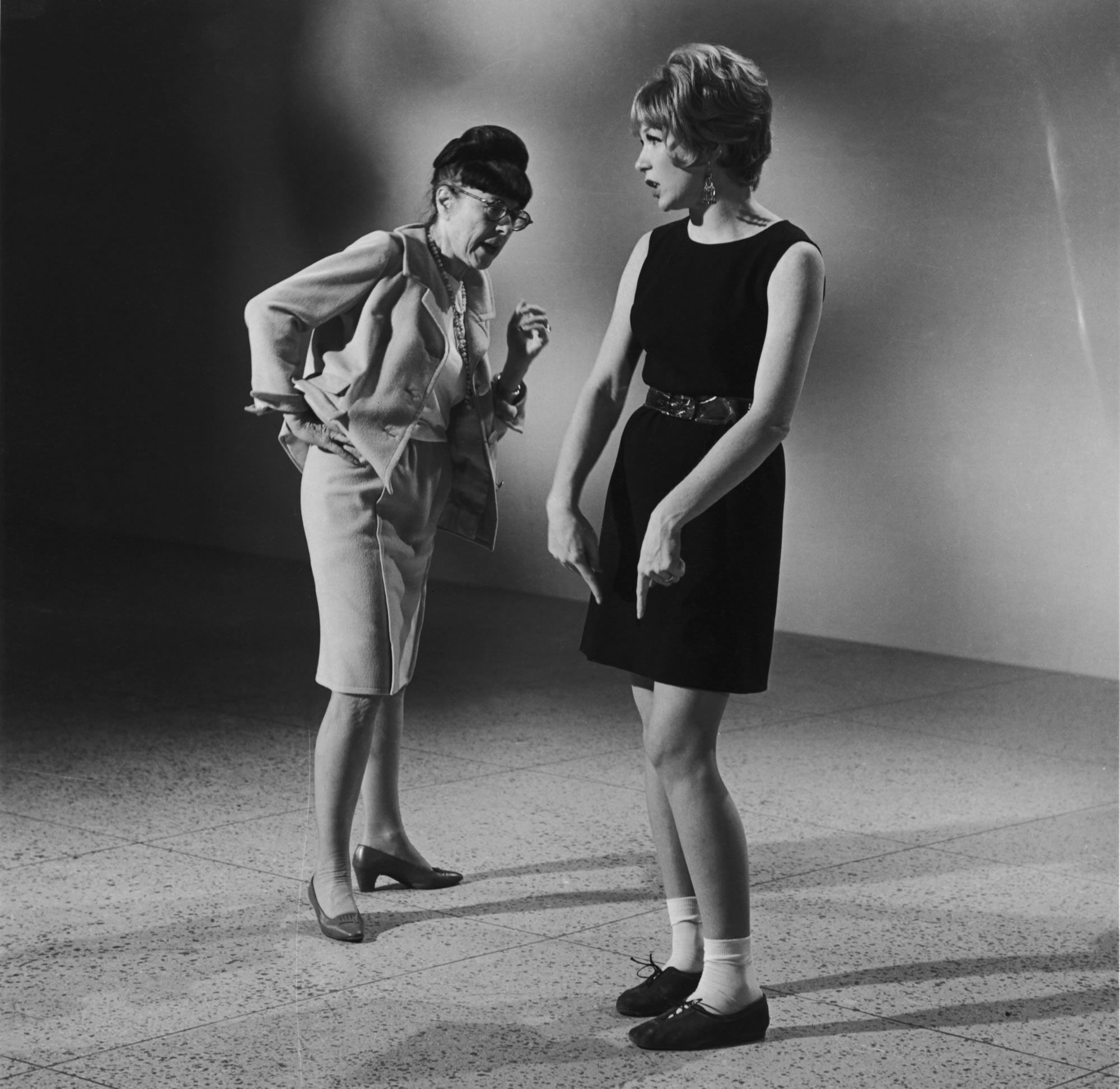Designing clothes for movement is always a challenge, especially when it's a musical. Here Edith Head inspects Shirley MacLaine's dance-ready outfit for the 1969 Bob Fosse film.