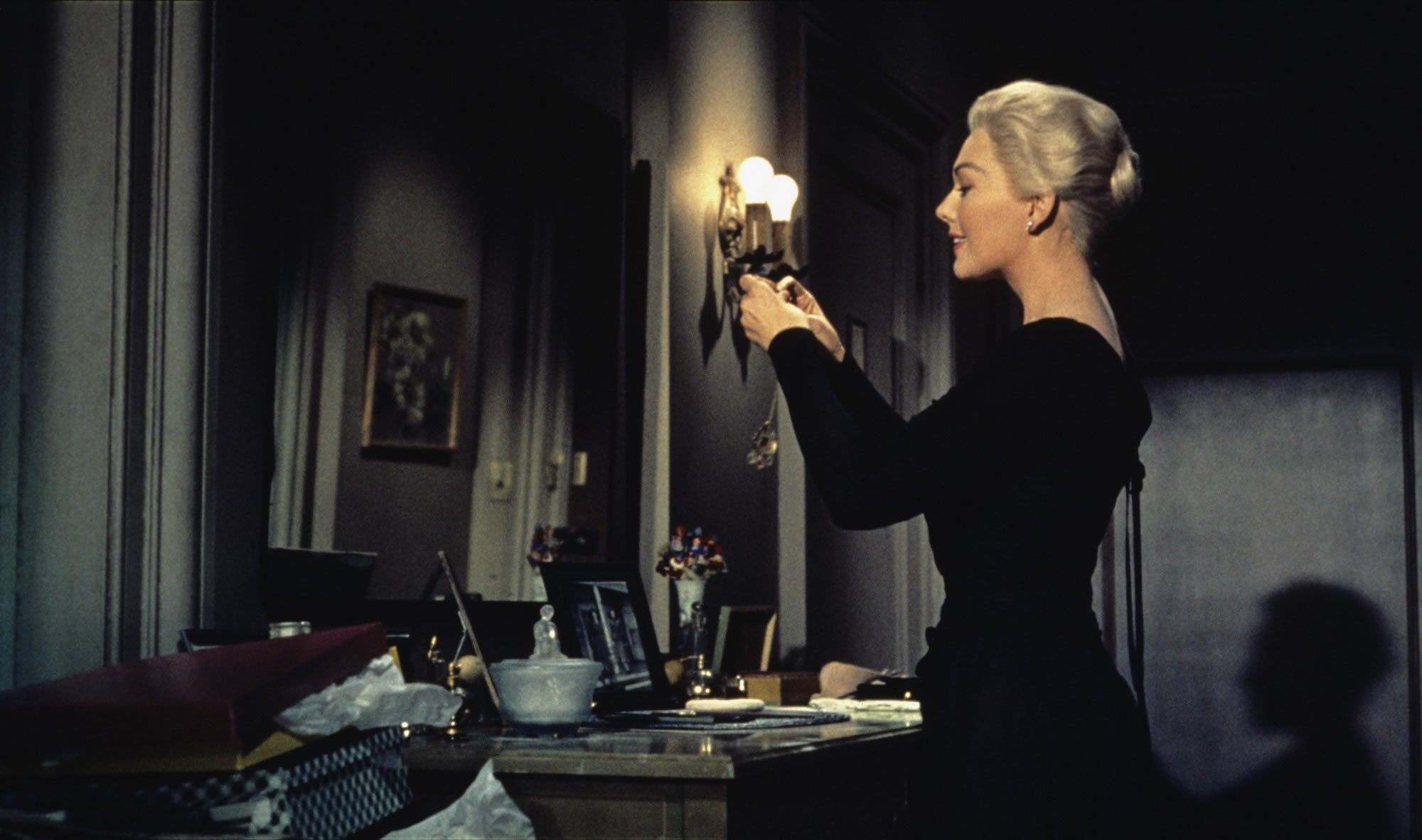 Kim Novak wears one of the most famous black dresses in film history, an Edith Head design for Alfred Hitchcock's classic 1958 thriller. The film posed an unusual challenge since Head had to dress Novak as two different characters.